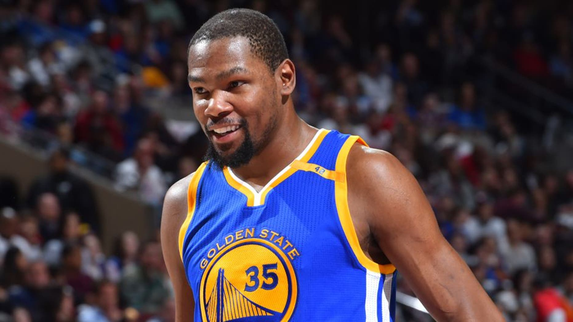 PHILADELPHIA, PA - FEBRUARY 27: Kevin Durant #35 of the Golden State Warriors looks on against the Philadelphia 76ers at Wells Fargo Center on February 27, 2017 in Philadelphia, Pennsylvania NOTE TO USER: User expressly acknowledges and agrees that, by downloading and/or using this Photograph, user is consenting to the terms and conditions of the Getty Images License Agreement. Mandatory Copyright Notice: Copyright 2017 NBAE (Photo by Jesse D. Garrabrant/NBAE via Getty Images)