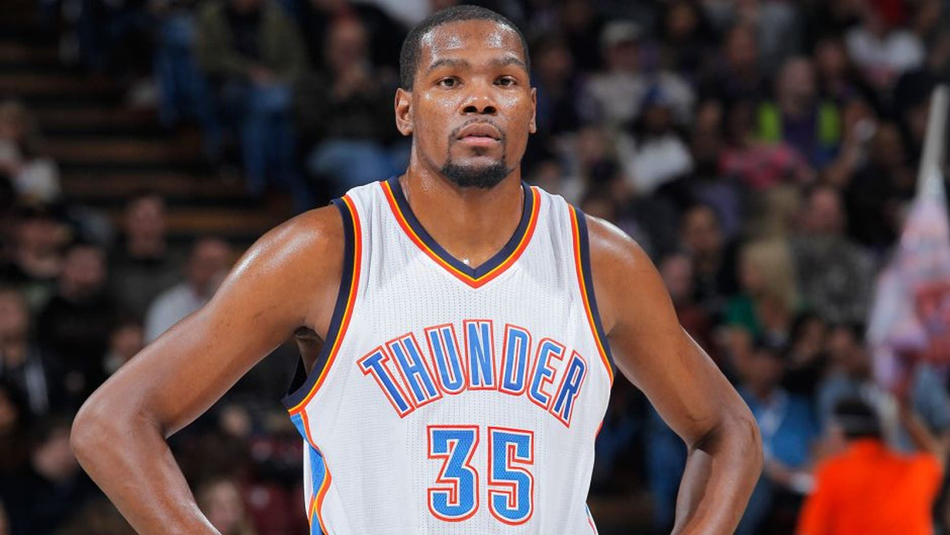 SACRAMENTO, CA - DECEMBER 16: Kevin Durant #35 of the Oklahoma City Thunder looks on during the game against the Sacramento Kings on December 16, 2014 at Sleep Train Arena in Sacramento, California. NOTE TO USER: User expressly acknowledges and agrees that, by downloading and or using this photograph, User is consenting to the terms and conditions of the Getty Images Agreement. Mandatory Copyright Notice: Copyright 2014 NBAE (Photo by Rocky Widner/NBAE via Getty Images)