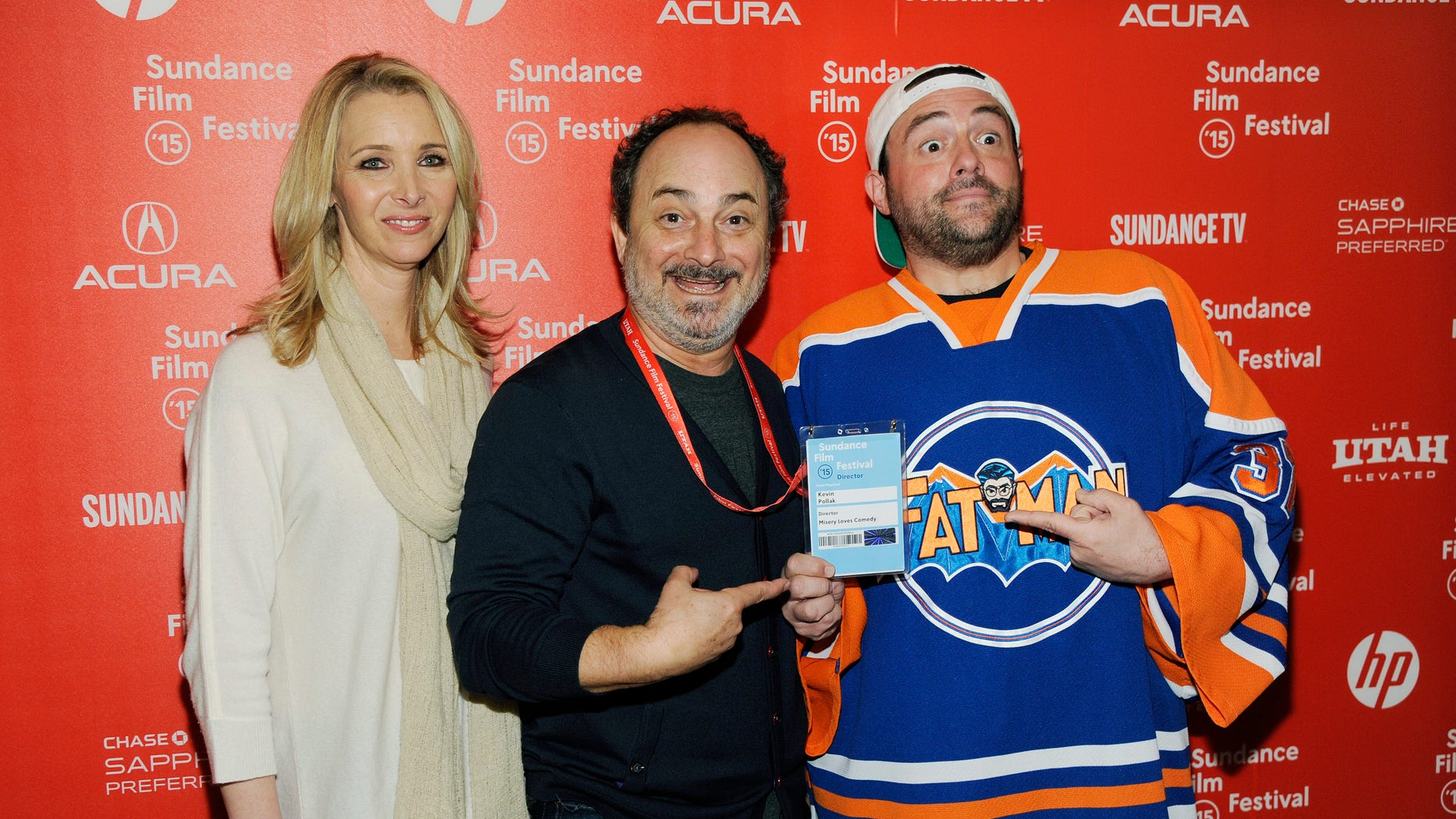 """Jan 22, 2015. Kevin Pollak, director and co-writer of the documentary film """"Misery Loves Comedy,"""" center, poses with cast members Lisa Kudrow, left, and Kevin Smith at the premiere of the film at the Egyptian Theatre at the 2015 Sundance Film Festival in Utah."""