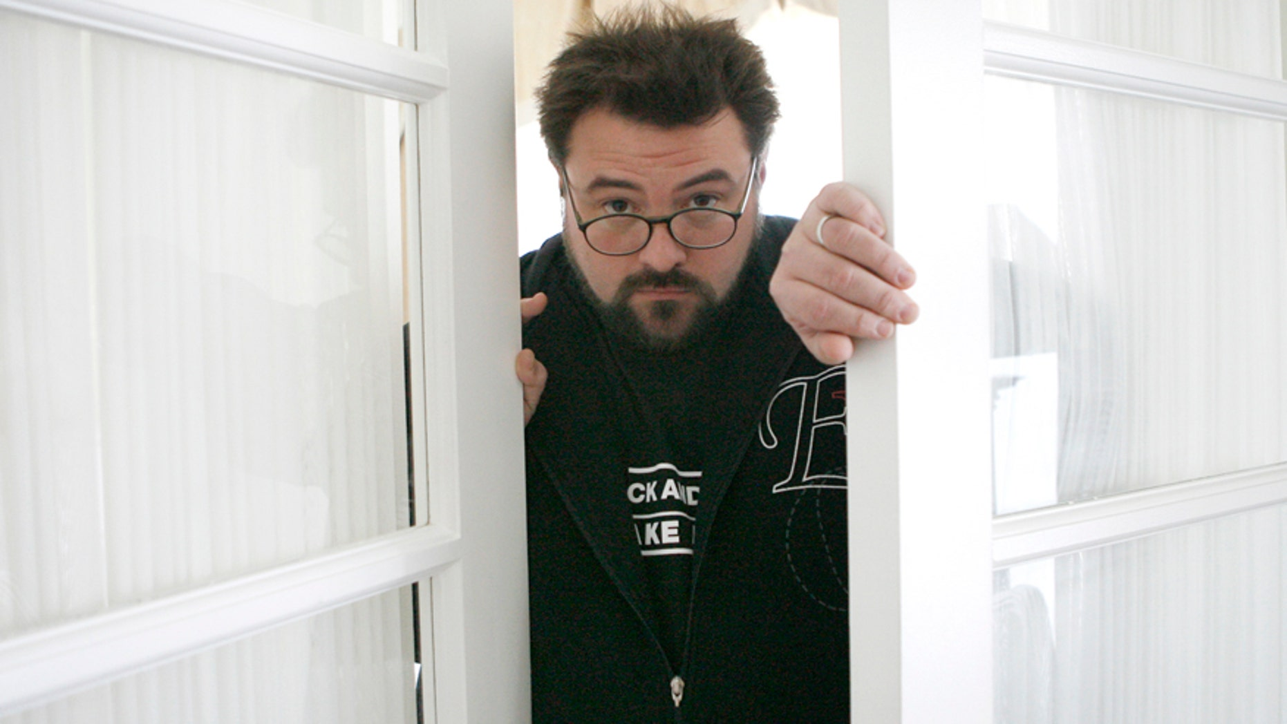 "Kevin Smith, director and writer of the movie ""Zack and Miri Make a Porno"", poses in Los Angeles October 19, 2008."