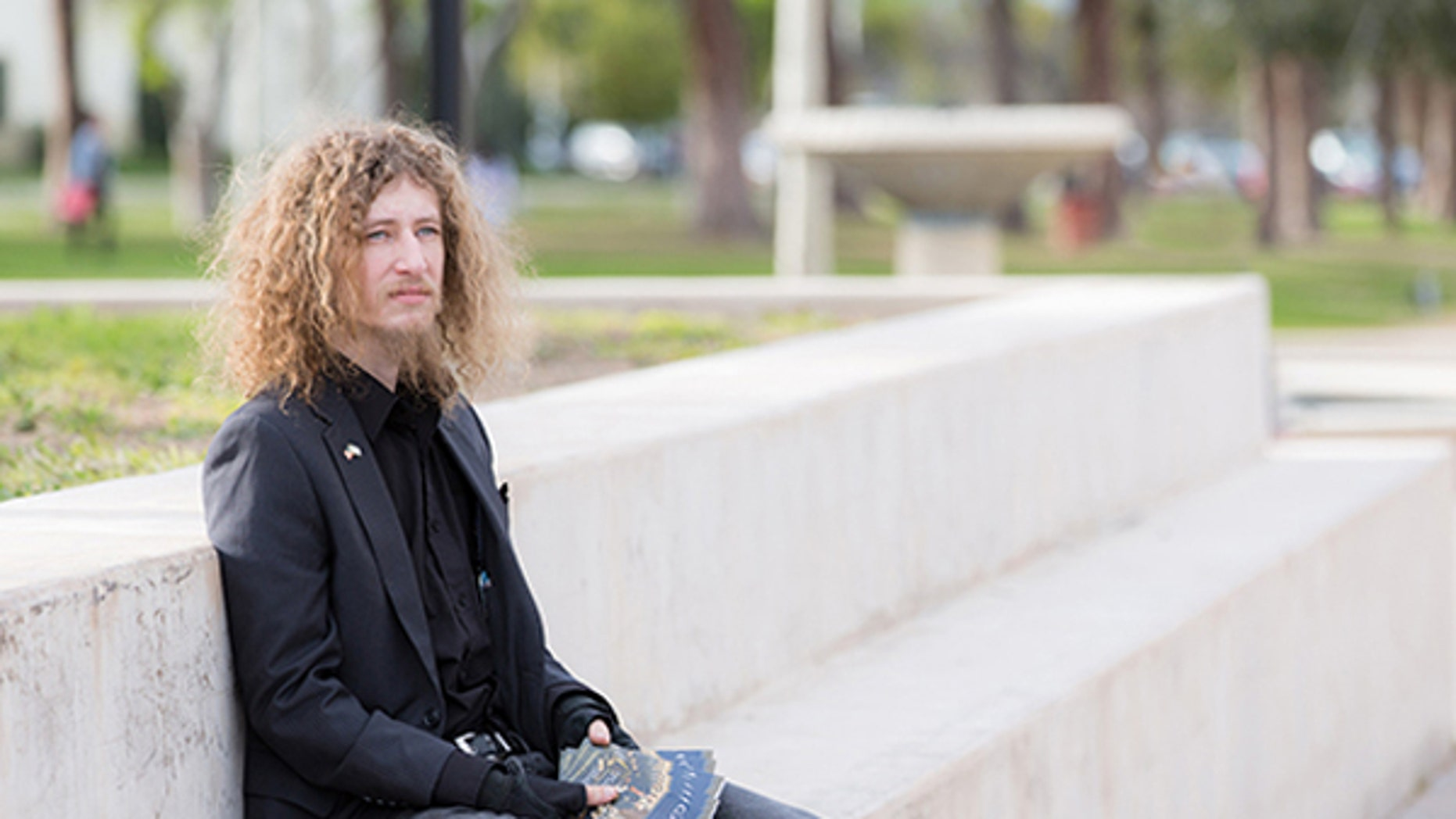 "Pierce College student, Kevin Shaw, 27, filed a lawsuit against the Los Angeles Community College District after he was barred from passing out copies of a document because he wasn't in the designated ""free speech zone"" on campus. School officials settled the lawsuit earlier this week when they abandoned use of the zones."