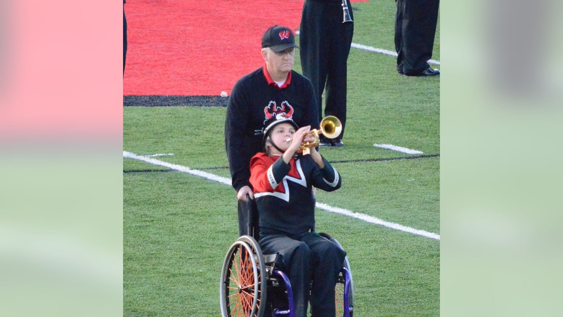 Kevin and Eva Houston perform during the marching band's halftime routine.