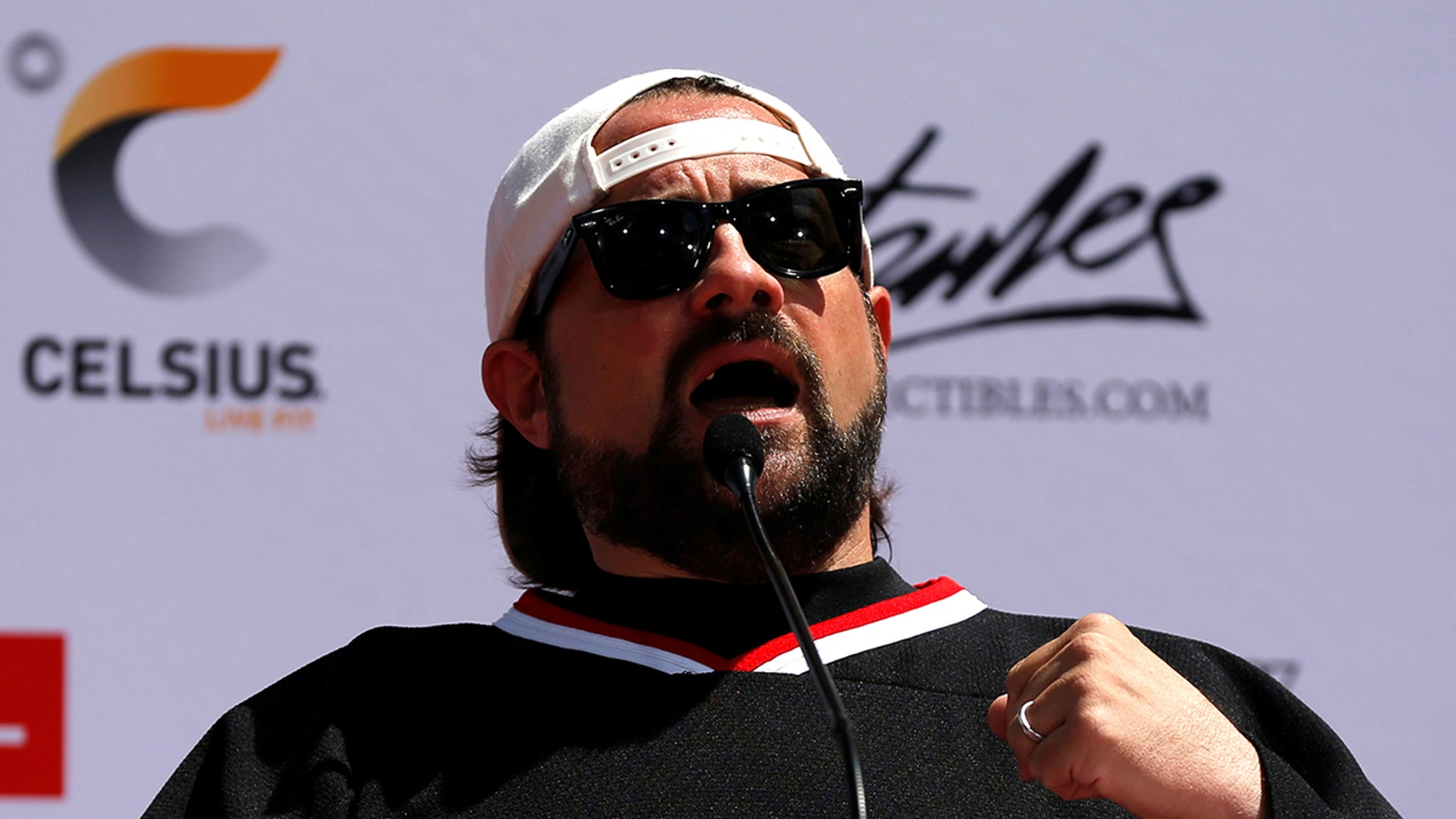 Director Kevin Smith speaks at a ceremony for Marvel co-creator Stan Lee to place his handprints, footprints and signature in cement in the forecourt of the TCL Chinese theatre in Los Angeles, California, U.S., July 18, 2017.   REUTERS/Mario Anzuoni - RC1FA799CC00