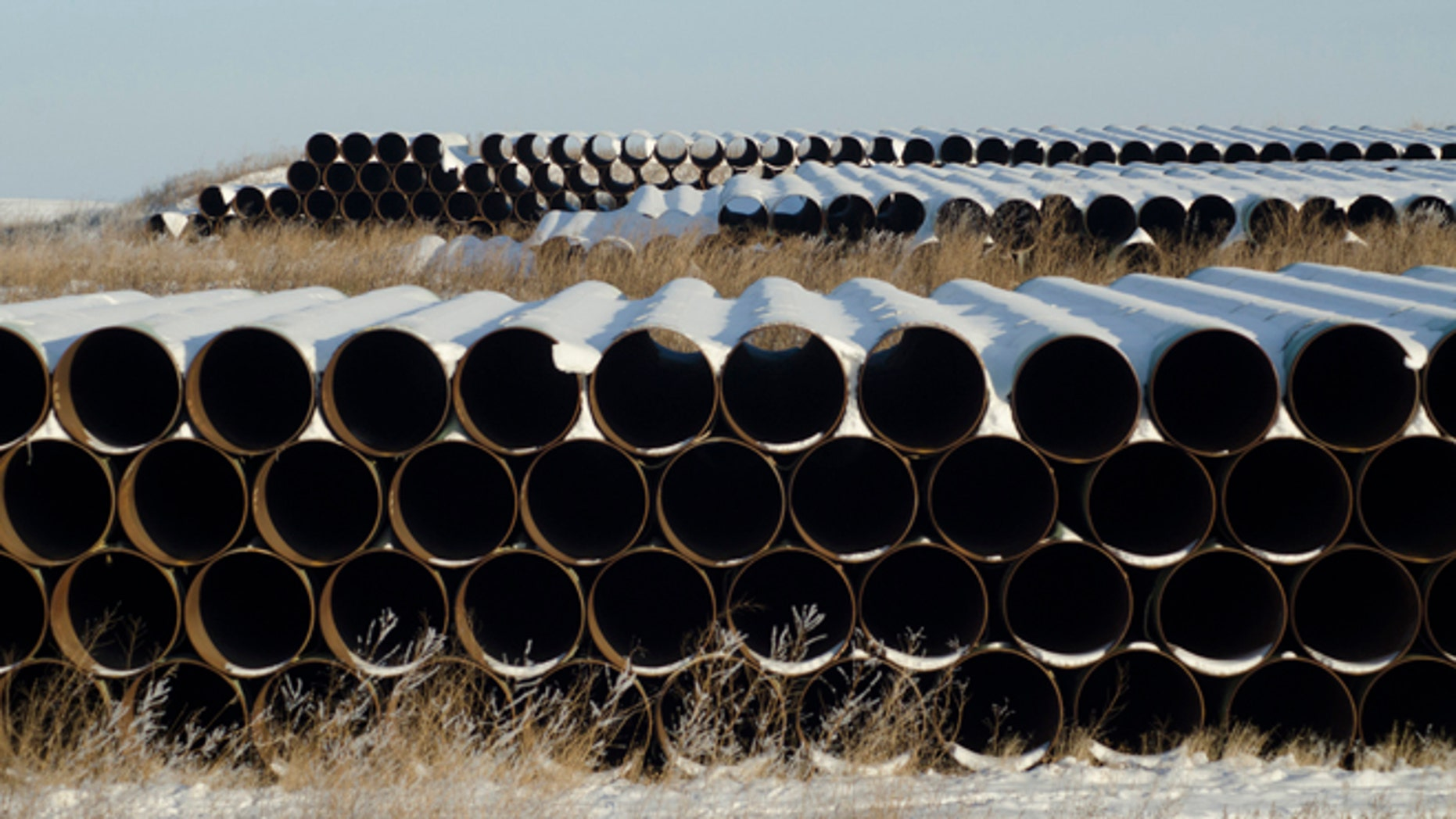 This Nov. 14, 2014 file photo shows a depot used to store pipes for Transcanada Corp's planned Keystone XL oil pipeline in Gascoyne, N.D.