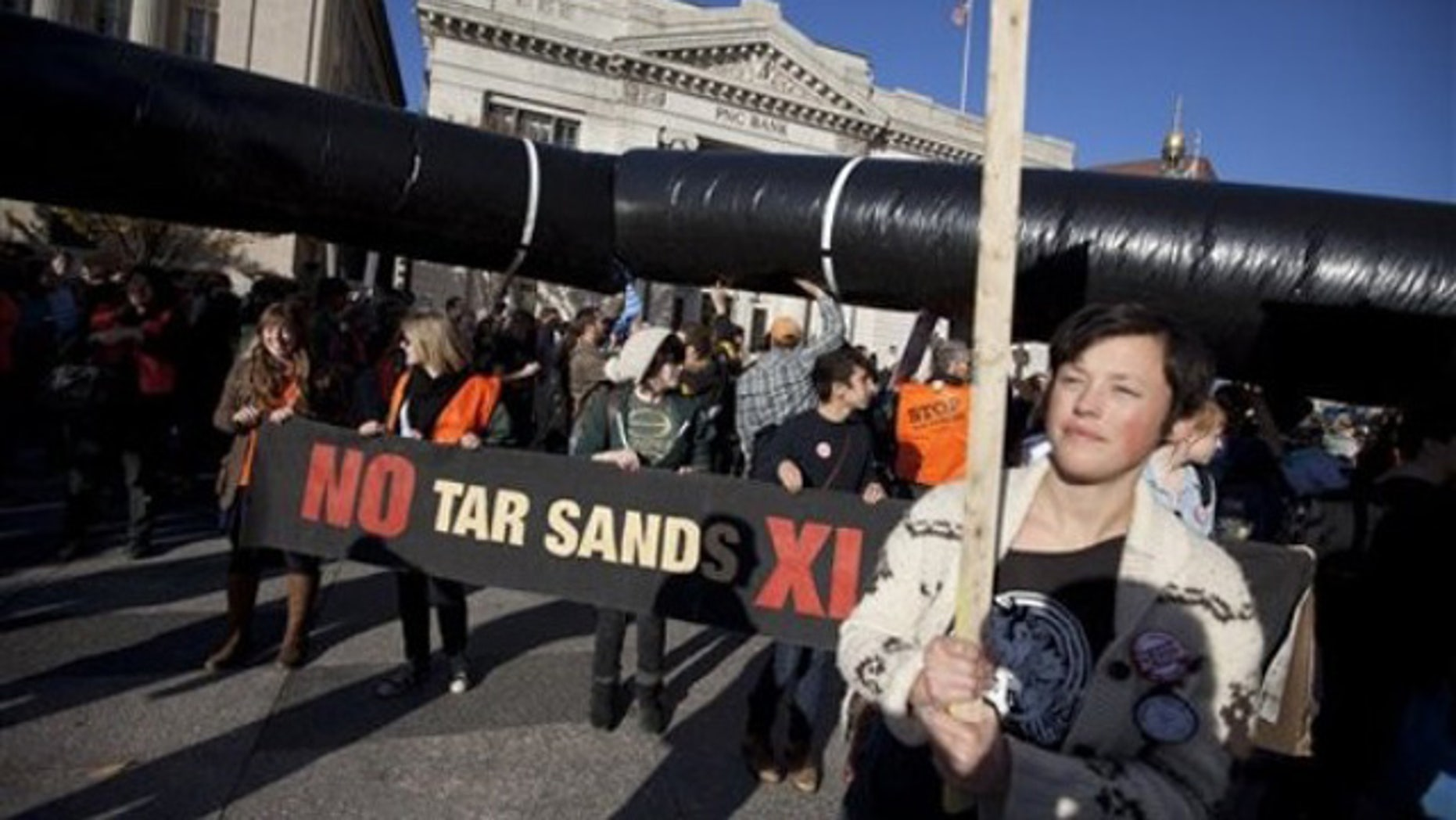 Nov. 6, 2011: Demonstrators march with a replica of a pipeline during a protest to demand a stop to the Keystone XL tar sands oil pipeline in Washington, D.C.