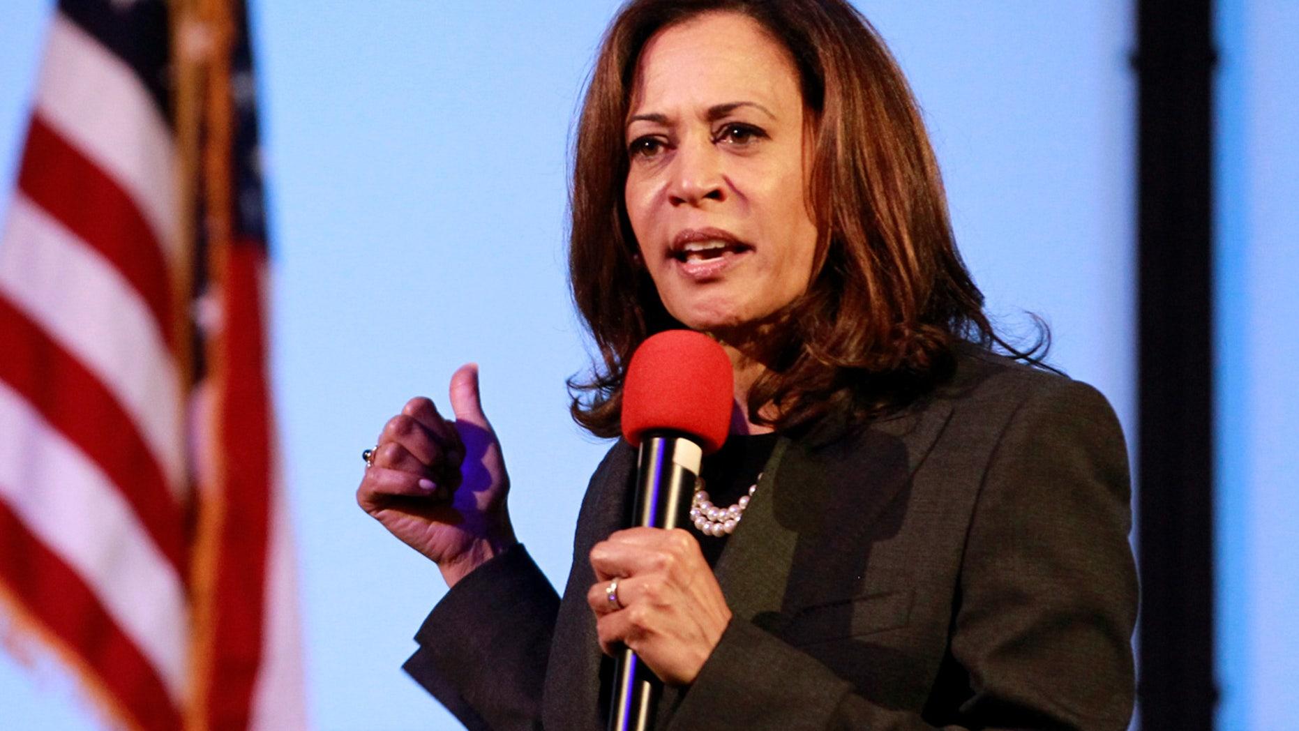 FILE 2018: U.S. Senator Kamala Harris, D-Calif., holds a town hall meeting in Sacramento.