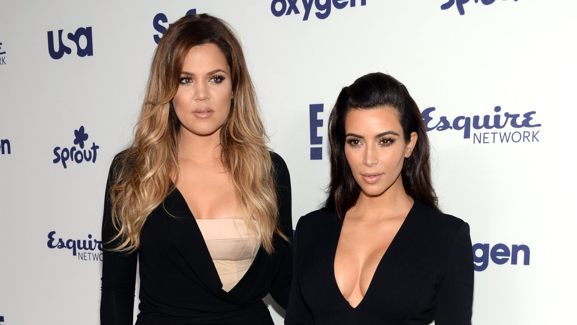 May 15, 2014. Khloe Kardashian, left, and Kim Kardashian arrive at the NBCUniversal Cable Entertainment 2014 Upfront at the Javits Center in New York.