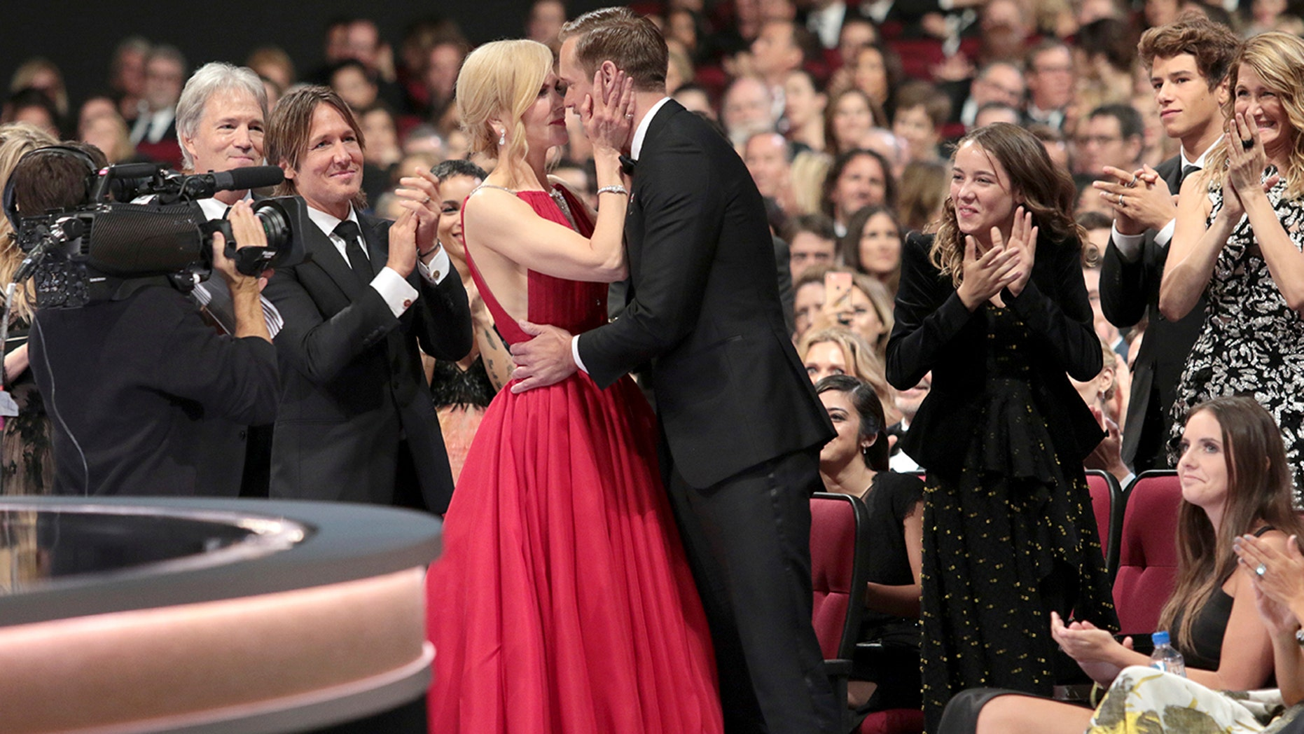 """IMAGE DISTRIBUTED FOR THE TELEVISION ACADEMY - Nicole Kidman, left, congratulates Alexander Skarsgard after winning the award for outstanding supporting actor in a limited series or a movie for """"Big Little Lies"""" at the 69th Primetime Emmy Awards on Sunday, Sept. 17, 2017, at the Microsoft Theater in Los Angeles. (Photo by Alex Berliner/Invision for the Television Academy/AP Images)"""