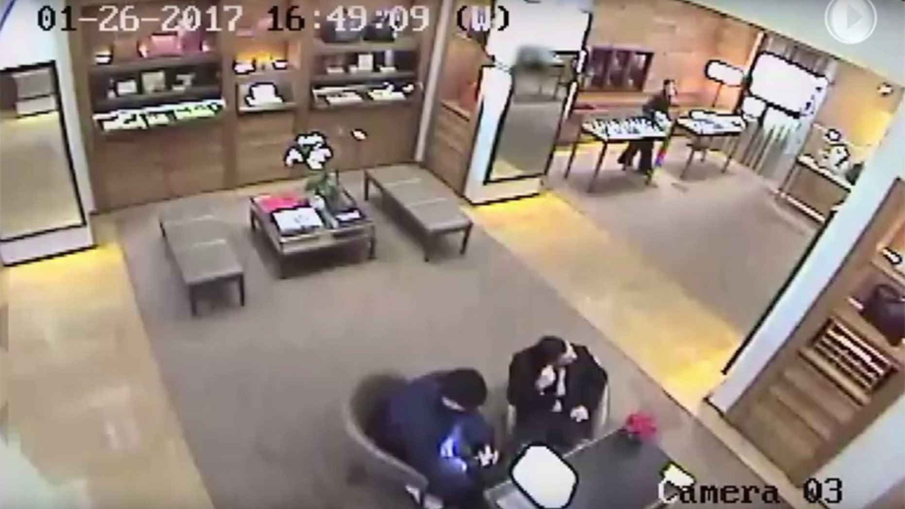 Screen grab of surveillance released by police about a student being forced to withdraw money.
