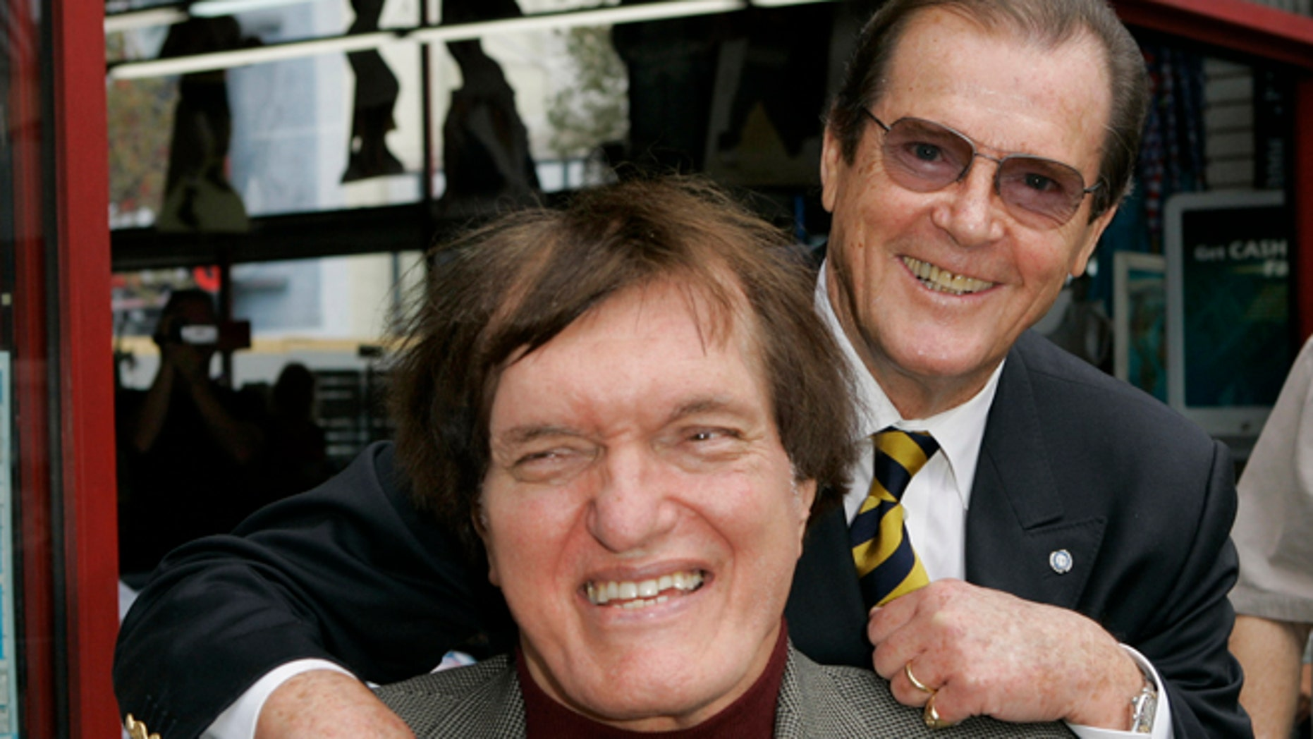 "Oct. 11, 2007: Actor Roger Moore, right, who played the part of James Bond in seven films, poses with actor Richard Kiel, who played the role of Jaws in ""The Spy Who Loved Me,""  during a ceremony honoring Moore with a star on the Hollywood Walk of Fame in Los Angeles."