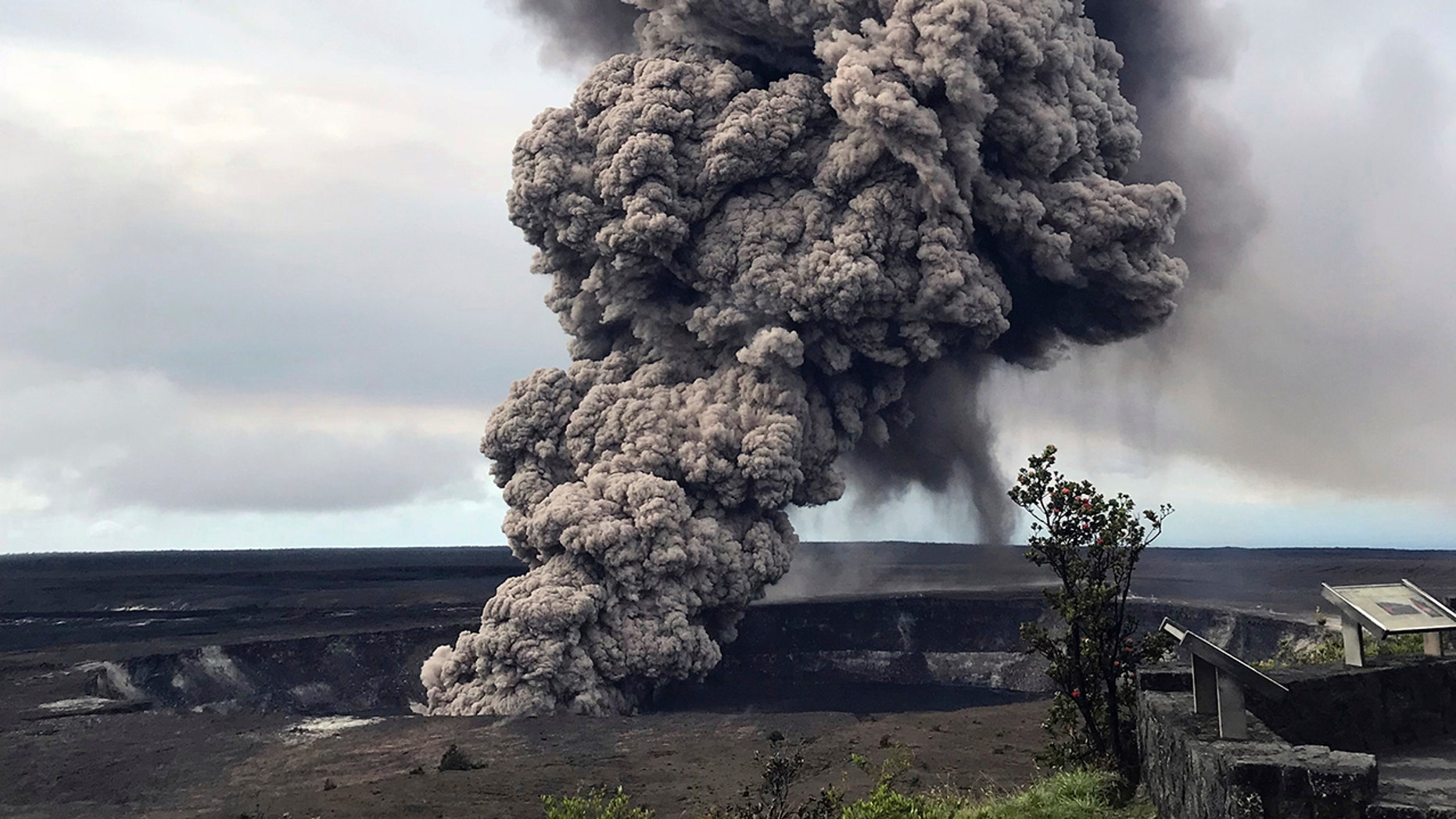 An ash column rises Wednesday from the overlook at Halema'uma'u Crater at the summit of Kilauea Volcano in Hawaii Volcanoes National Park on the island of Hawaii.
