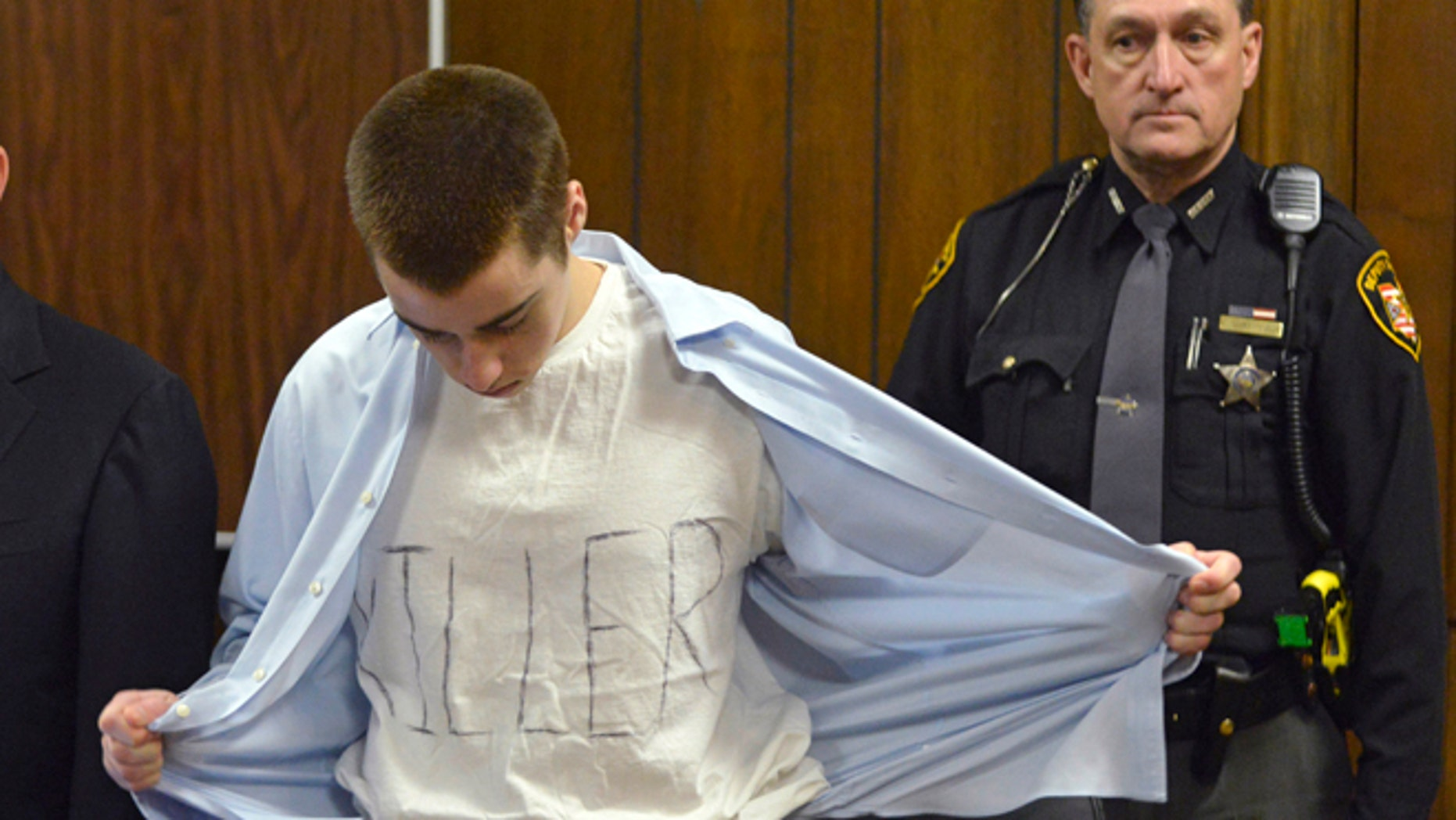 March 19: T.J. Lane unbuttons his shirt during sentencing Tuesday, March 19, 2013, in Chardon, Ohio.