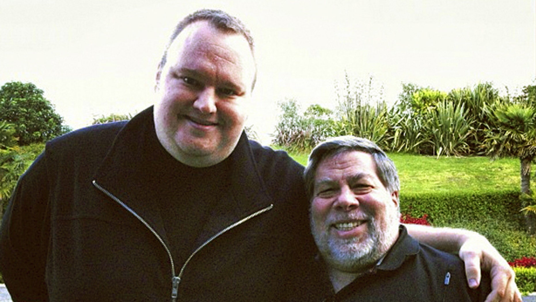 "June 27, 2012: Apple cofounder Steve Wozniak, right, and Kim Dotcom, founder of file-sharing site Megaupload, stand together in Auckland, New Zealand. Wozniak said the U.S. piracy case against Dotcom is ""hokey"" and a threat to Internet innovation."