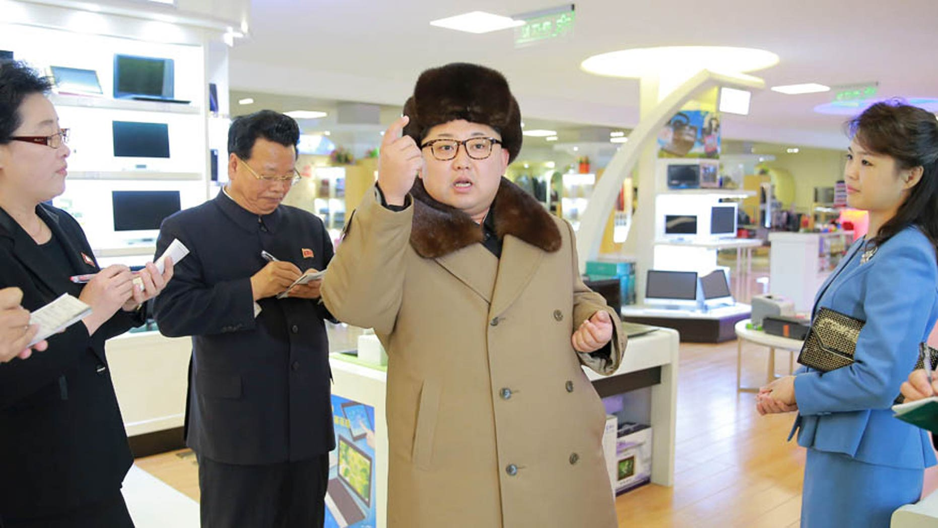 North Korean leader Kim Jong Un, together with his wife Ri Sol Ju (R), gives field guidance at the newly built Mirae Shop and Health Complex in this undated photo released by North Korea's Korean Central News Agency (KCNA) on March 28, 2016