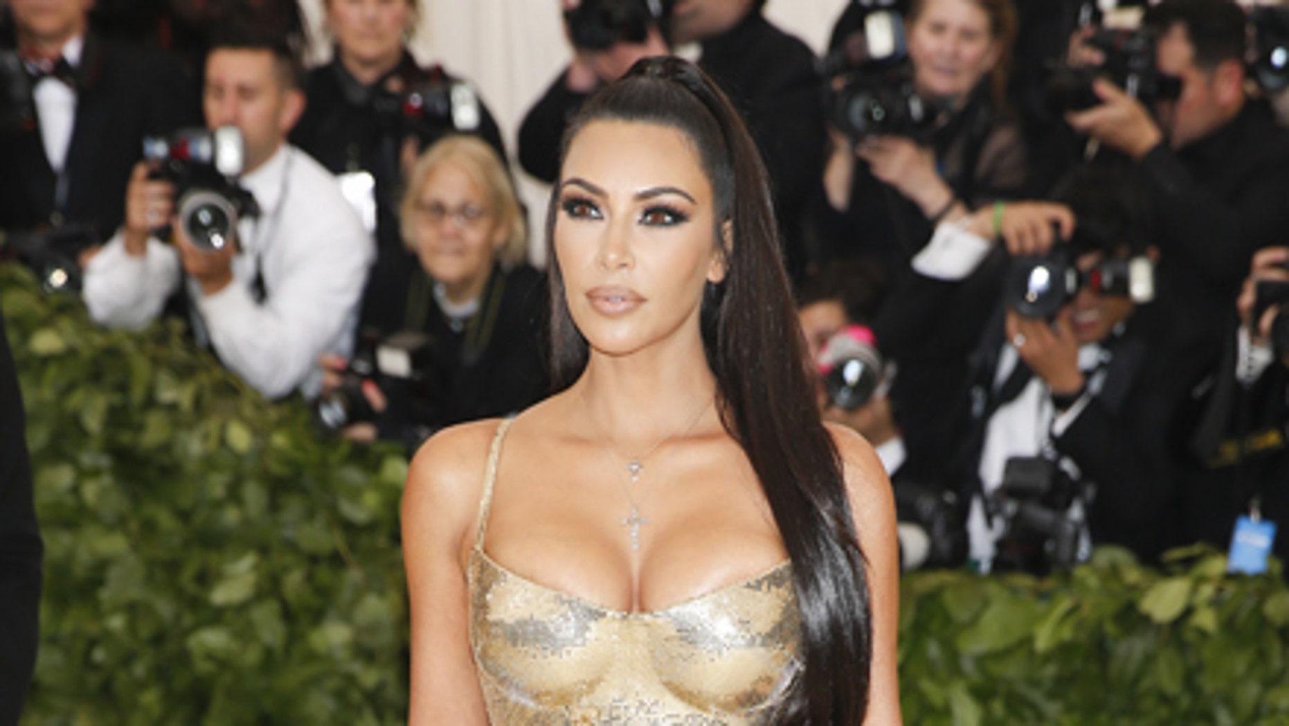 Kim Kardashian poses sans Kanye West at the Metropolitan Museum of Art Costume Institute Gala.