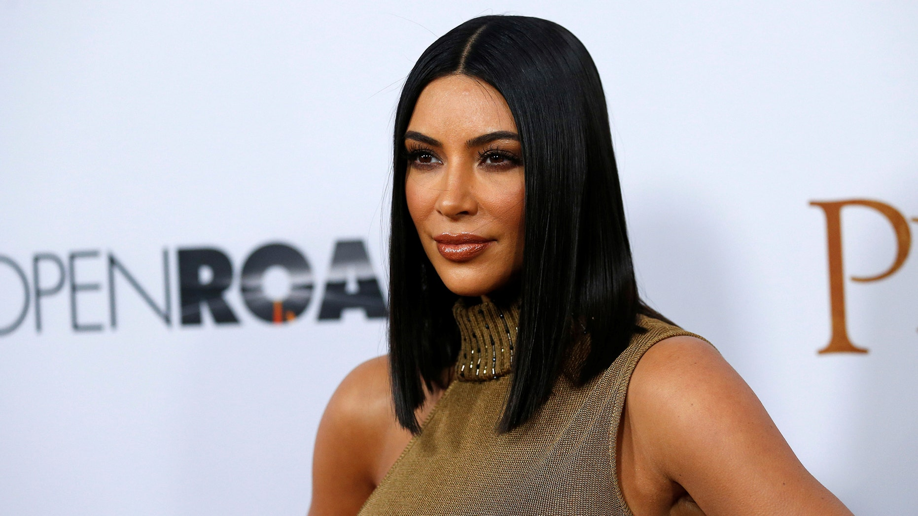 """Television personality Kim Kardashian poses at the premiere of """"The Promise"""" in Los Angeles, California U.S., April 12, 2017."""