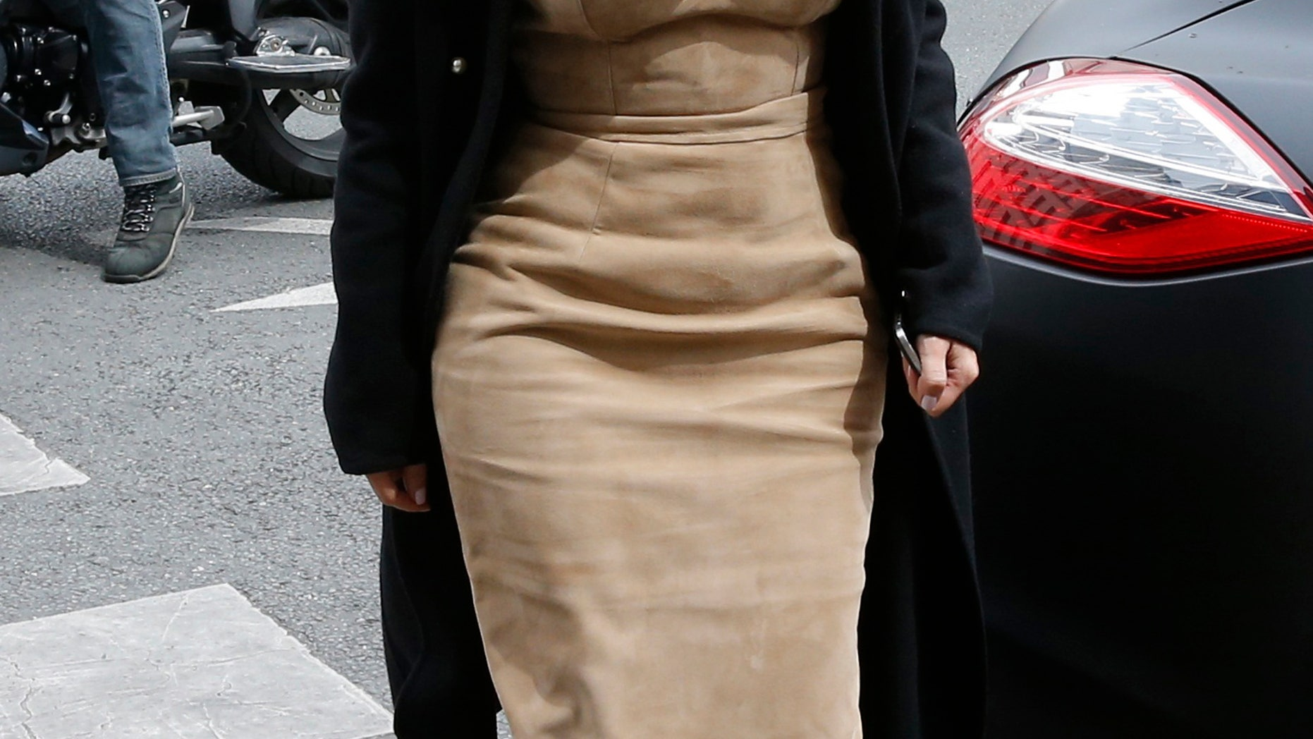 May 21, 2014. Kim Kardashian arrives at a fashion designer workshop in Paris.