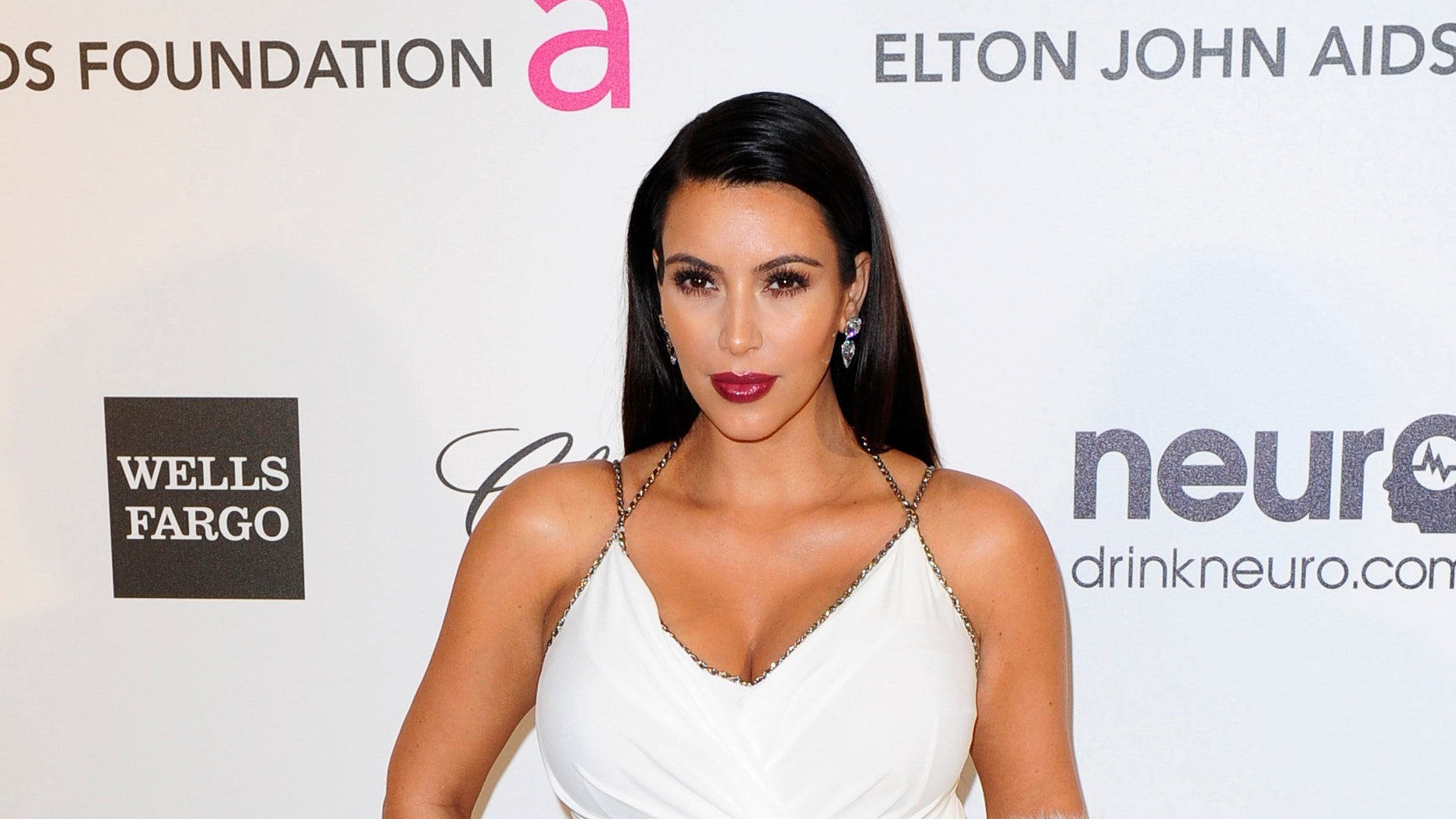 February 24, 2013. TV personality Kim Kardashian arrives at the 2013 Elton John AIDS Foundation Oscar Party in West Hollywood, California.