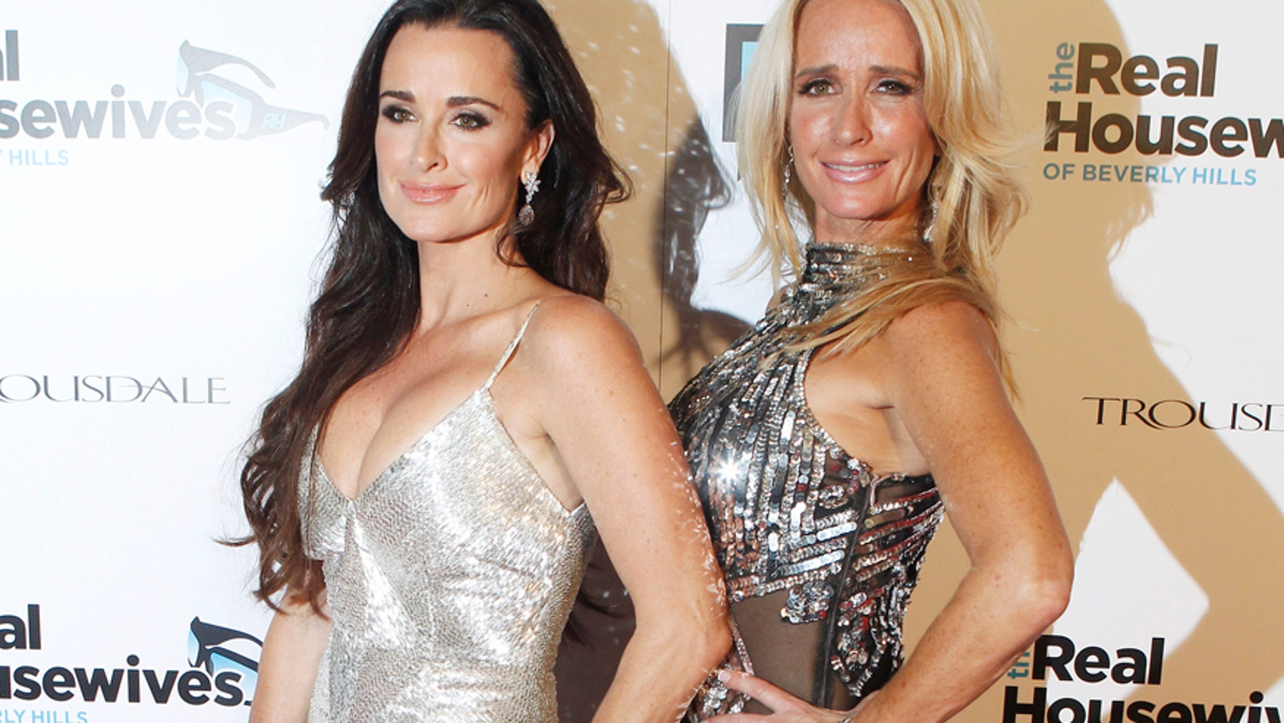 """Sisters and cast members of Bravo's new reality series """"The Real Housewives of Beverly Hills"""" Kyle Richards (L) and Kim Richards pose at the premiere party in Los Angeles October 11, 2010."""