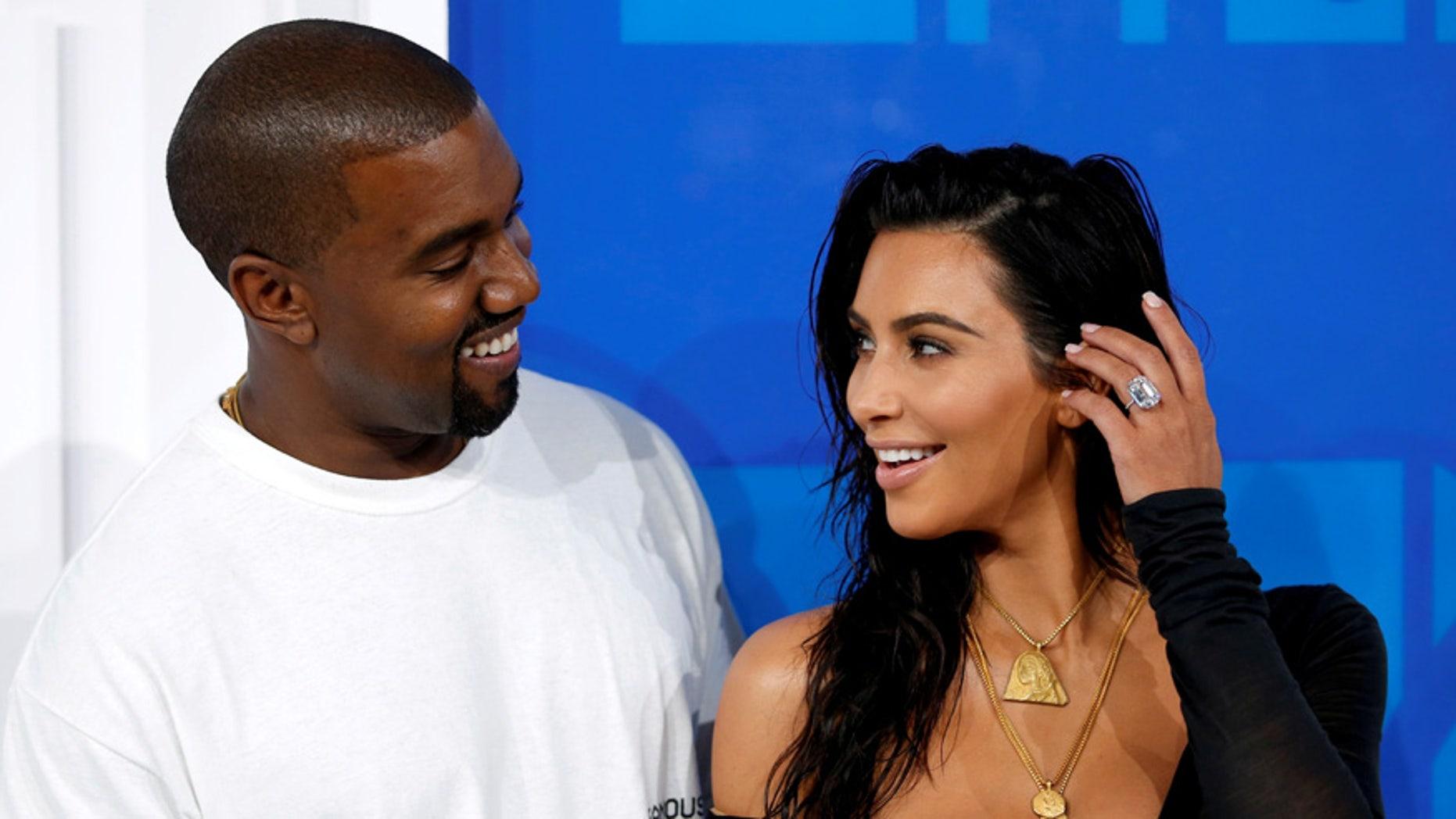 FILE PHOTO - Kim Kardashian and Kanye West arrive at the 2016 MTV Video Music Awards in New York, U.S., August 28, 2016. (REUTERS/Eduardo Munoz)