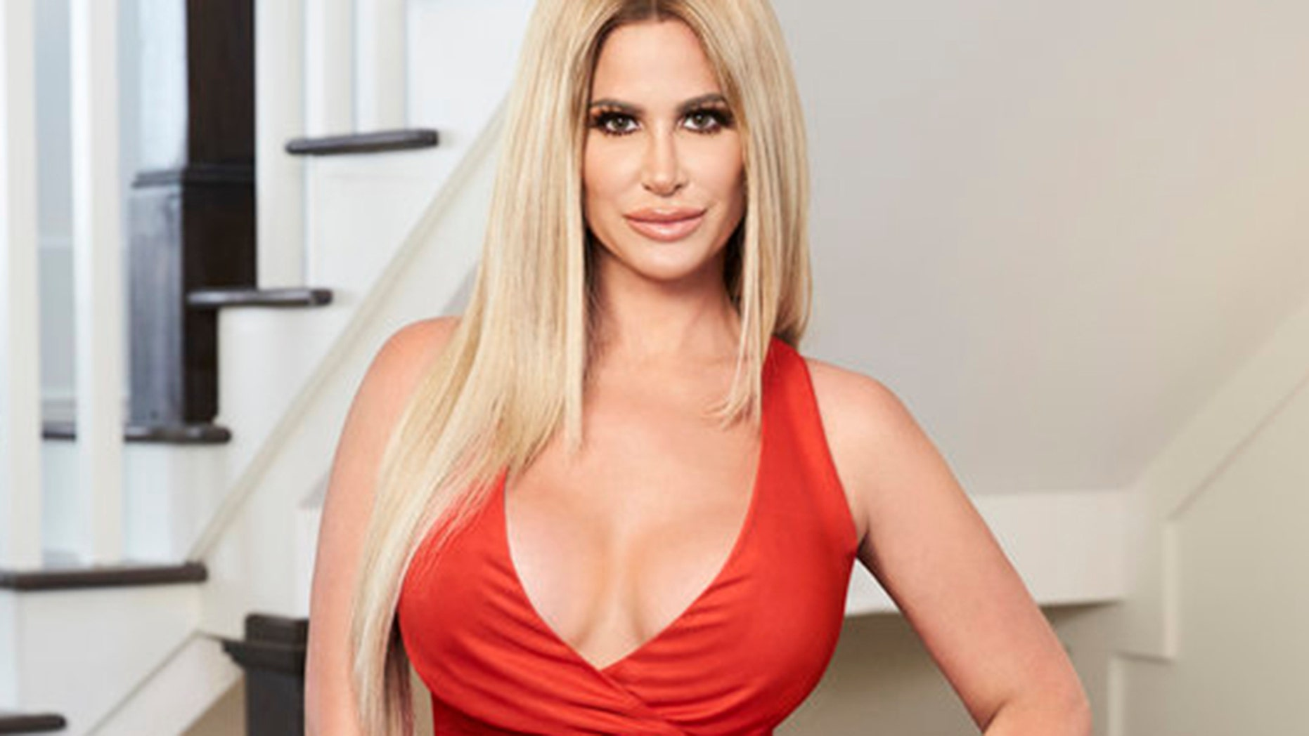 Kim Zolciak asked her fans for help to decide on whether she should have her implants removed for a smaller size.