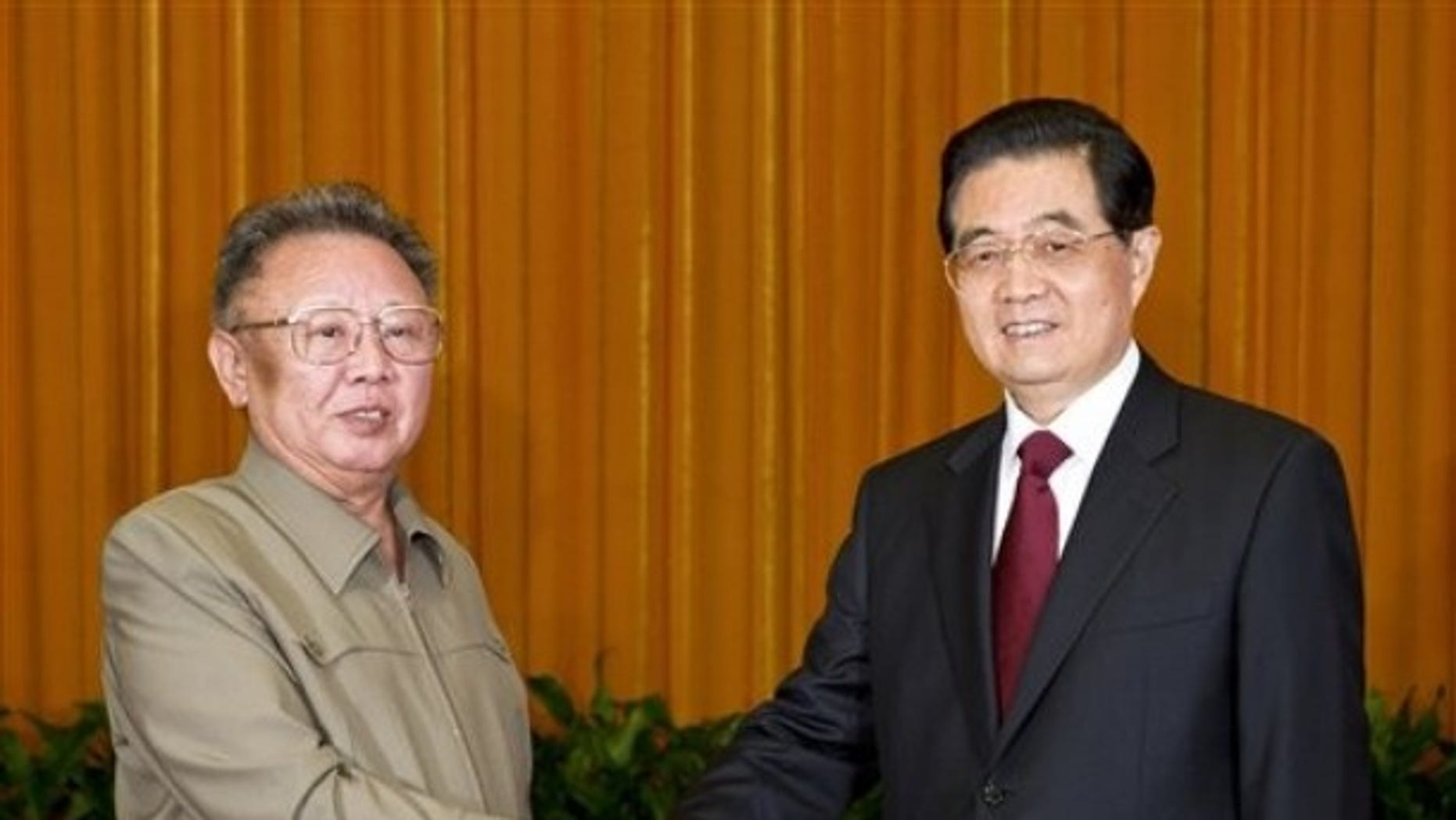 In this photo taken Wednesday, May 25, 2011 released by China's Xinhua news agency, North Korean leader Kim Jong Il, left, shakes hands with Chinese President Hu Jintao during a meeting in Beijing.