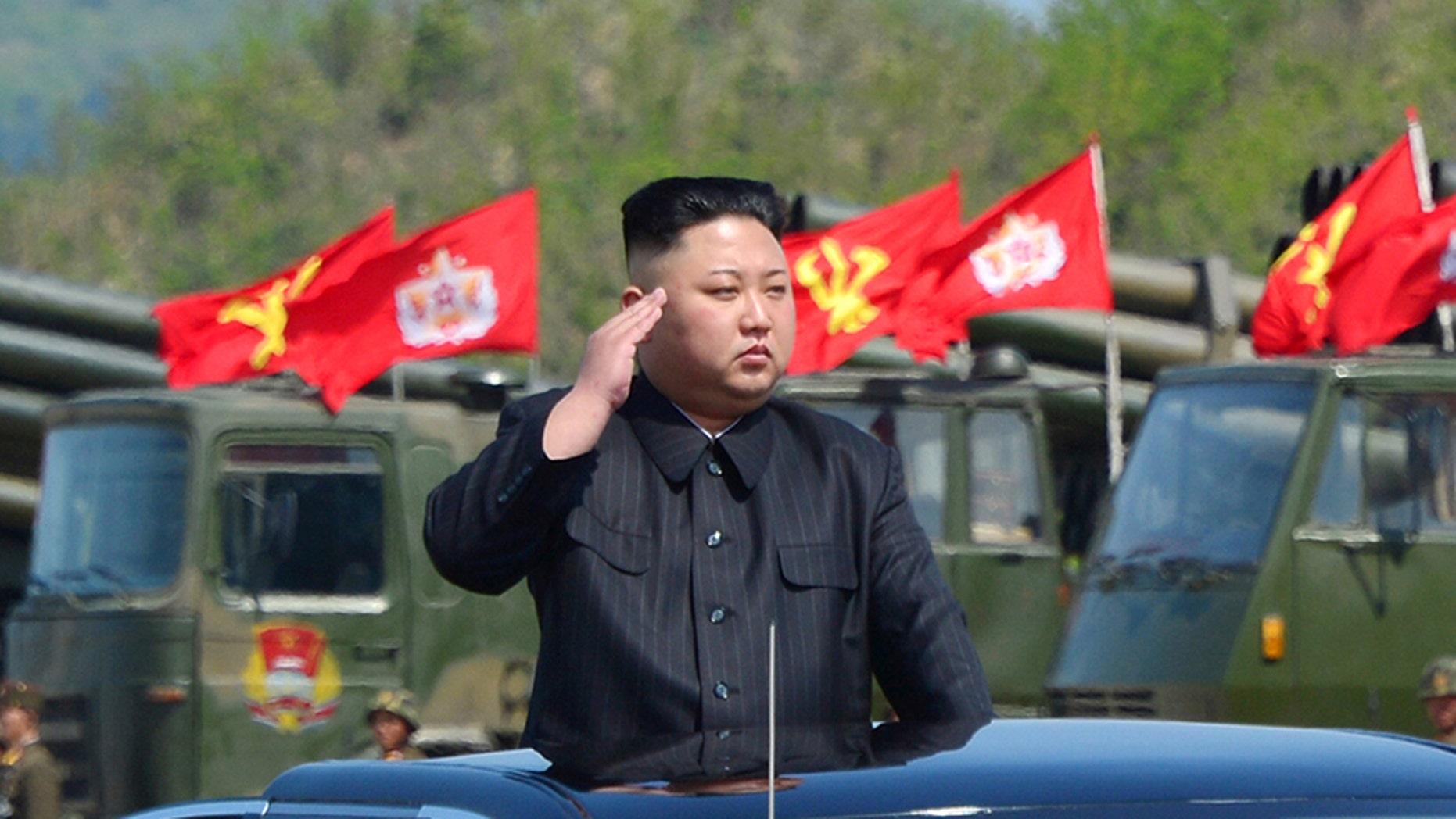 North Korea's leader Kim Jong Un watches a military drill, April 26, 2017.