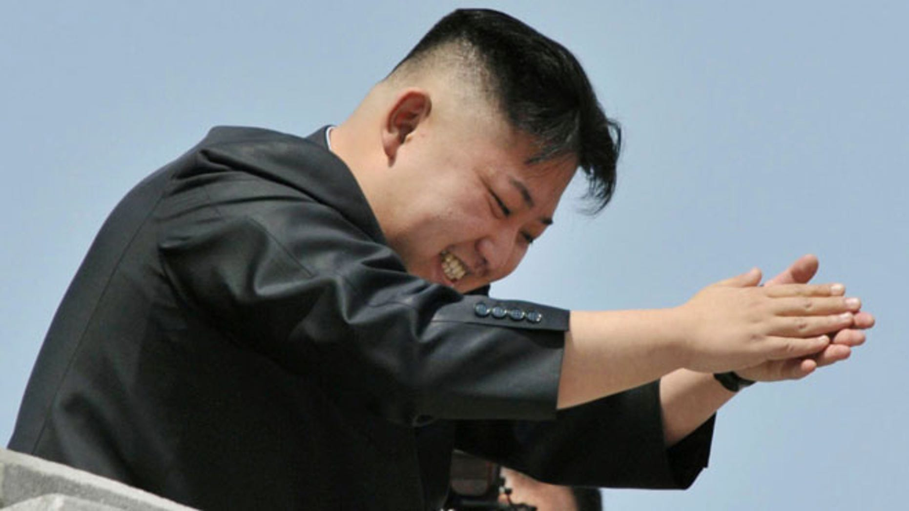 April 15, 2012: North Korean leader Kim Jong-un applauds as he leaves after a mass military parade in Pyongyang.