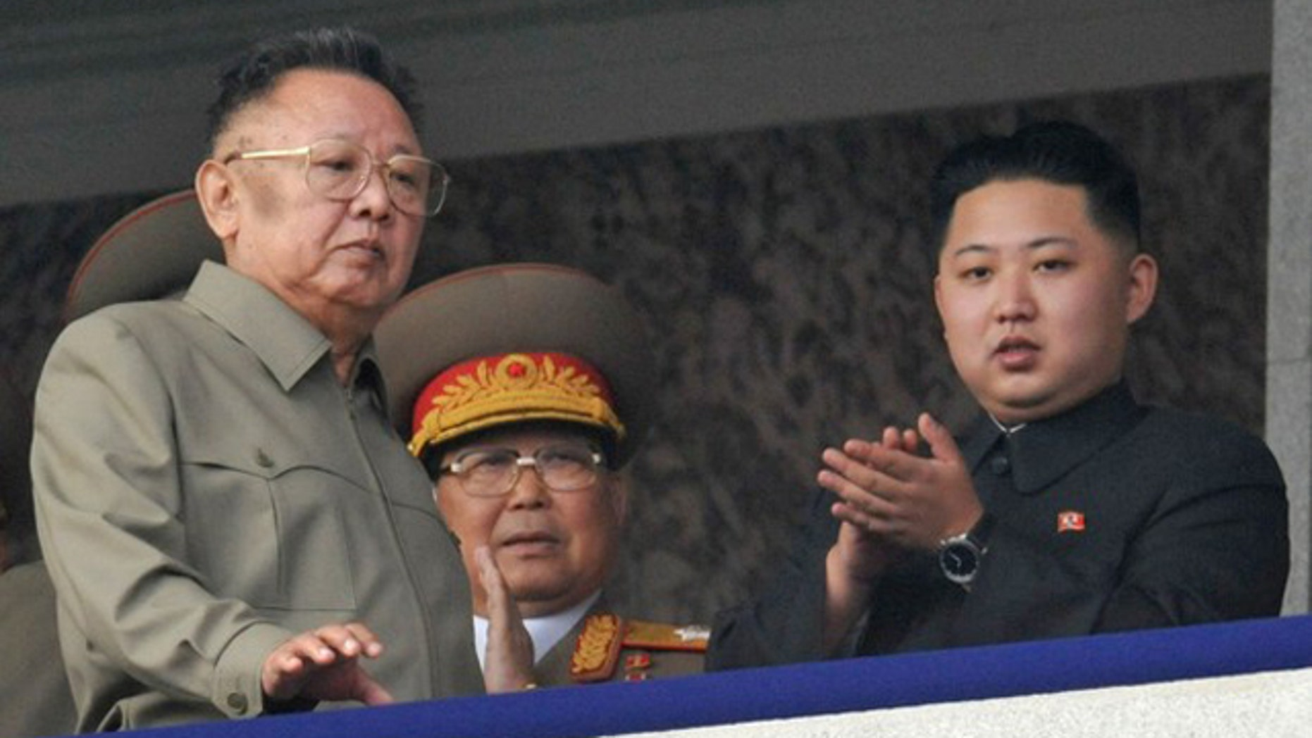 Oct 10: North Korean leader Kim Jong Il, left, walks in front of his youngest son Kim Jong Un as they watch a parade in Pyongyang.