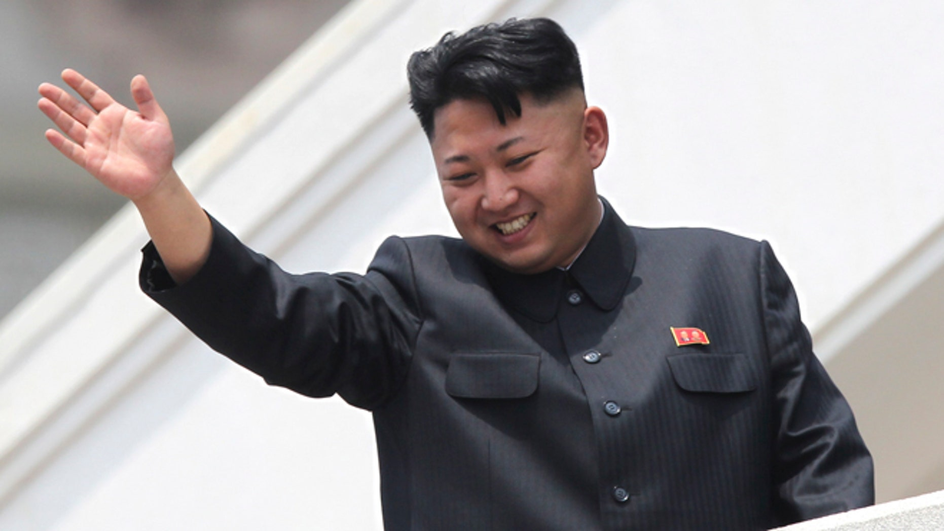 July 2013: North Korean leader Kim Jong Un waves to war veterans during a mass military parade celebrating the 60th anniversary of the Korean War armistice in Pyongyang.