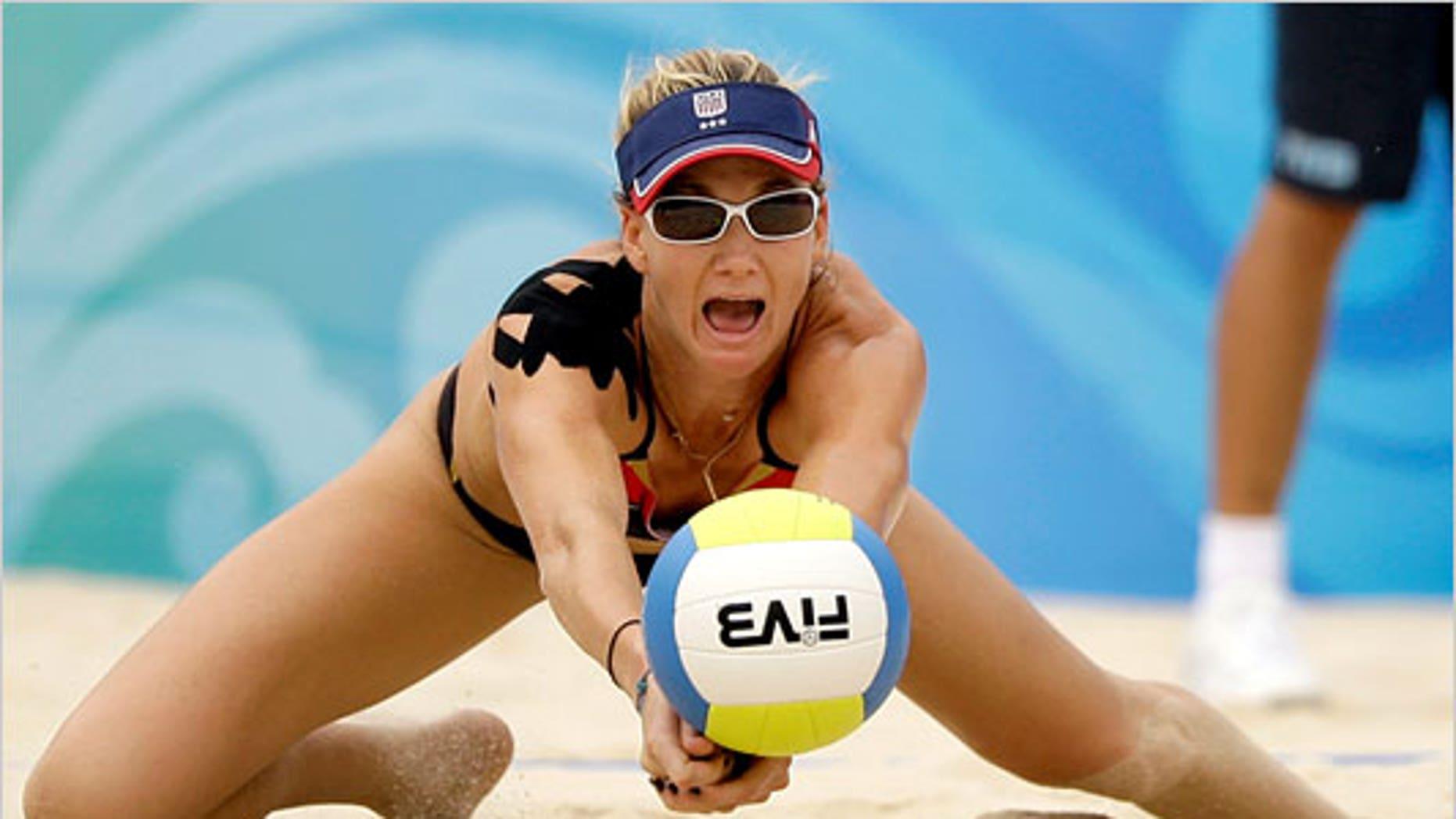 Beach volleyball champion Kerri Walsh wearing athletic tape. (Natacha Pisarenko/The Associated Press)