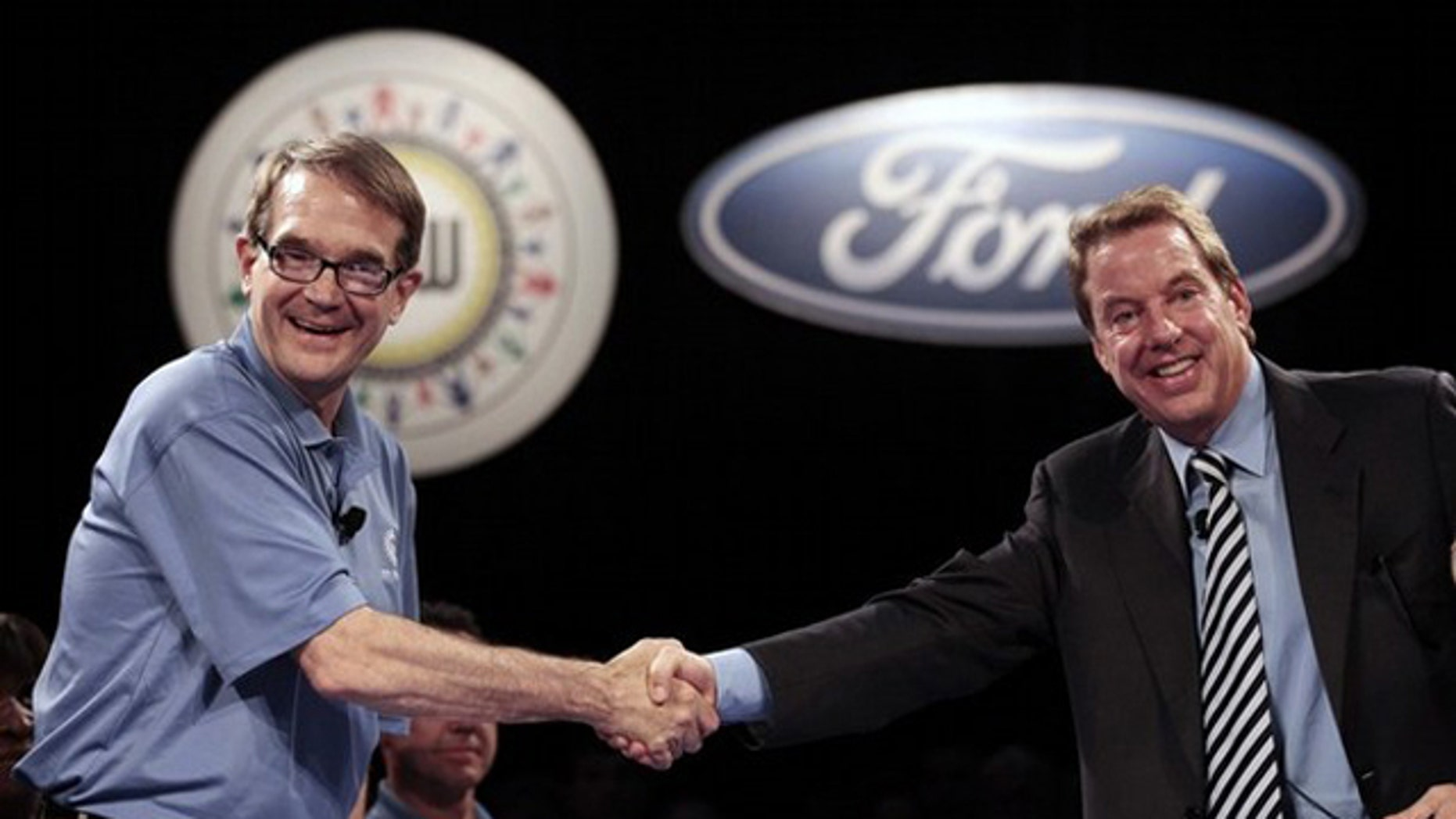 United Auto Workers Union President Bob King (L) and Ford Motor Co Executive Chairman Bill Ford shake hands to mark the beginning of labor contract negotiations at the Rouge Center in Dearborn, Michigan July 29, 2011.