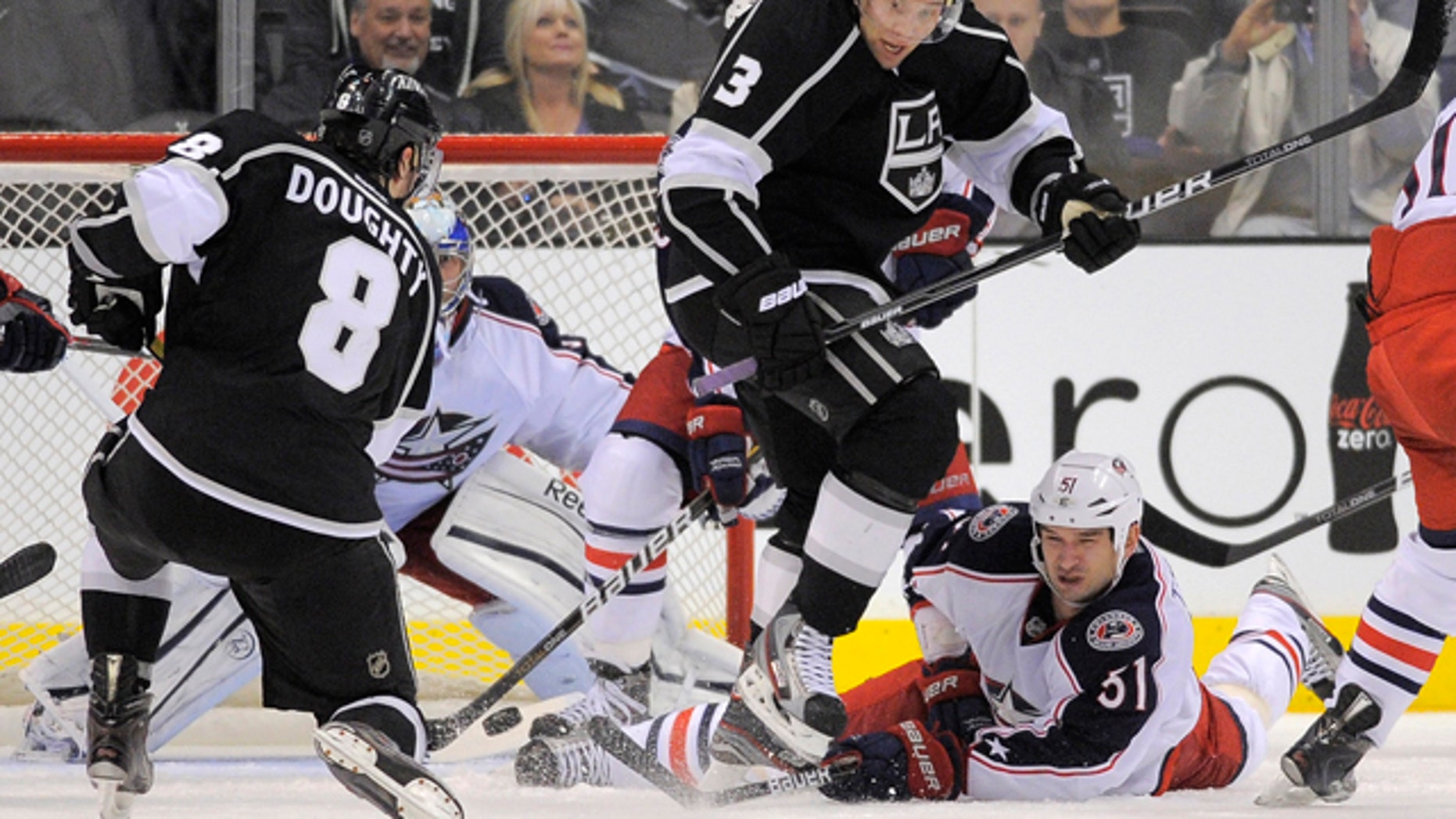 Feb. 1, 2012: Los Angeles Kings defenseman Drew Doughty, left, shoots and scores  to win the game on Columbus Blue Jackets goalie Curtis Sanford, second from left, as Los Angeles Kings defenseman Jack Johnson, second from right, jumps out of the way and Columbus Blue Jackets defenseman Fedor Tyutin of Russia falls during the third period of their NHL hockey game in Los Angeles. The Kings won 3-2.