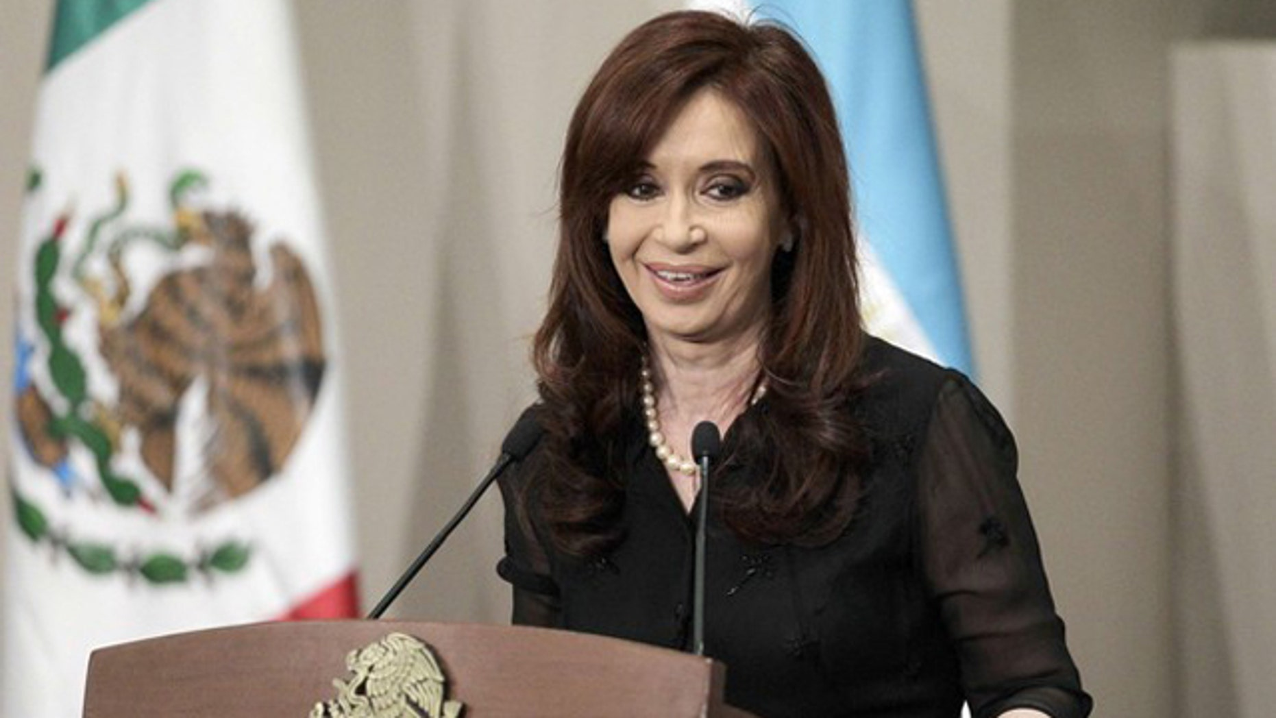 Argentina's President Cristina Fernandez de Kirchner smiles during a news conference in Mexico City May 30.