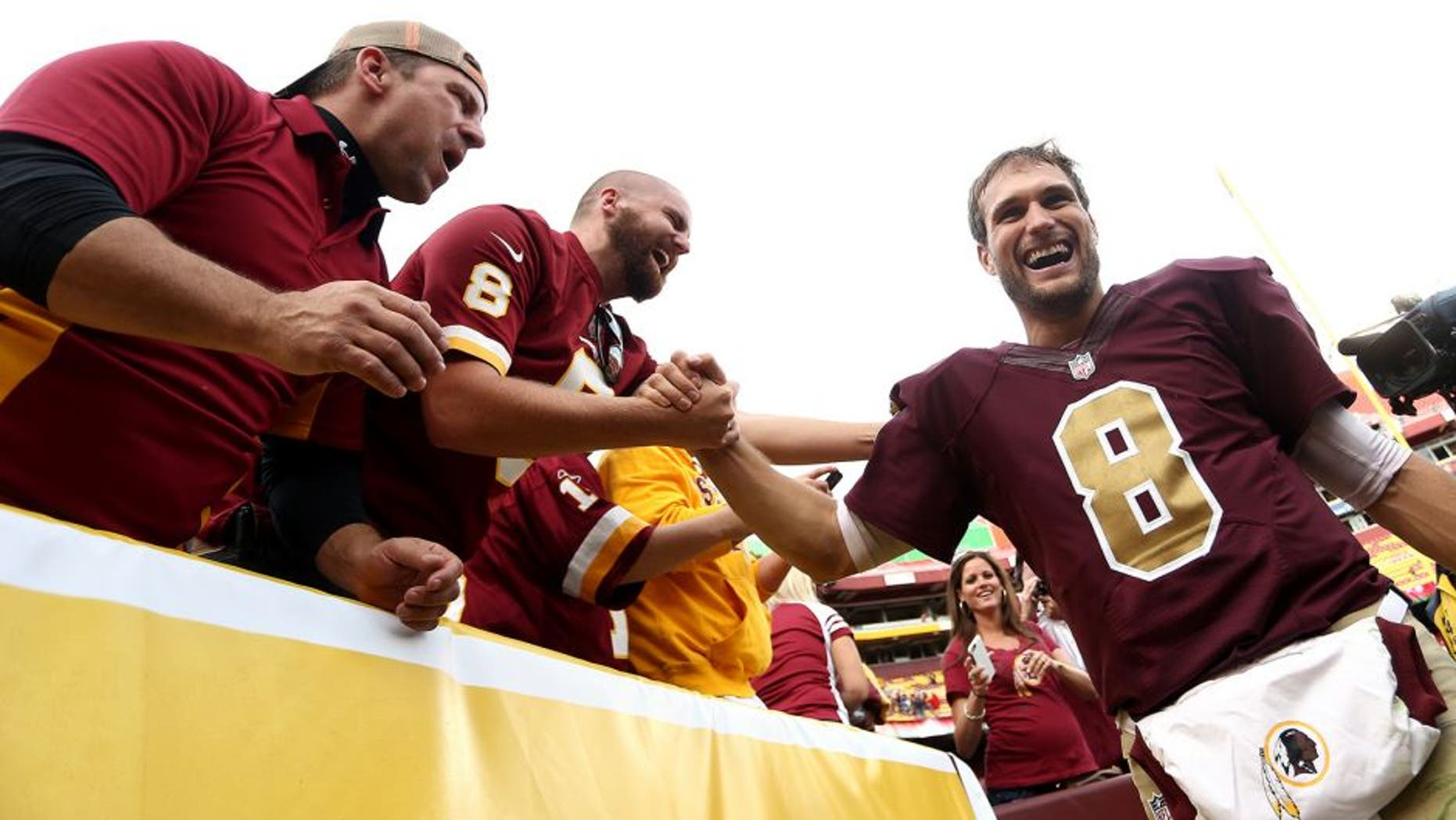 LANDOVER, MD - OCTOBER 25: Quarterback Kirk Cousins #8 of the Washington Redskins celebrates with fans after defeating the Tampa Bay Buccaneers 31-30 during a game at FedExField on October 25, 2015 in Landover, Maryland. (Photo by Matt Hazlett/Getty Images)