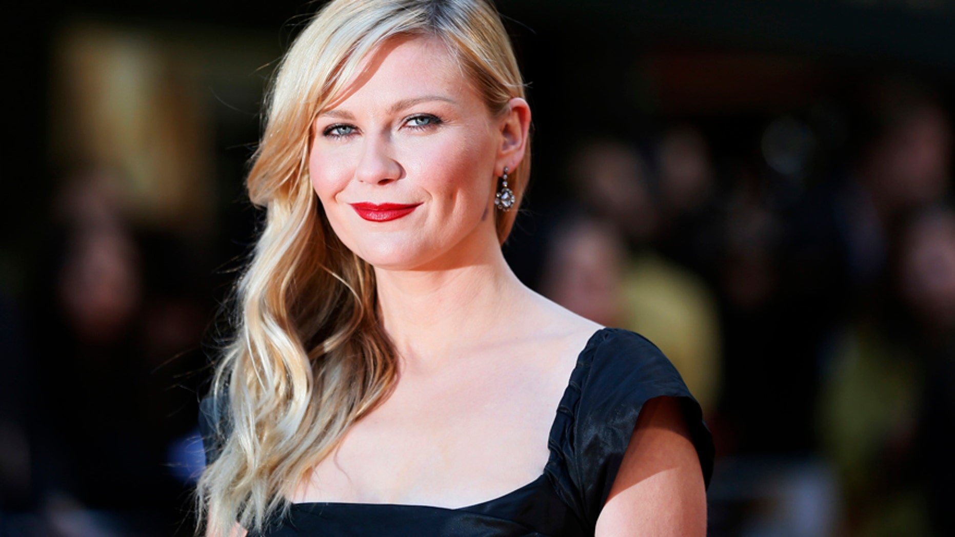 Actress Kirsten Dunst arrives for the British premiere of 'The Two Faces of January' at the Curzon Mayfair in London May 13, 2014.