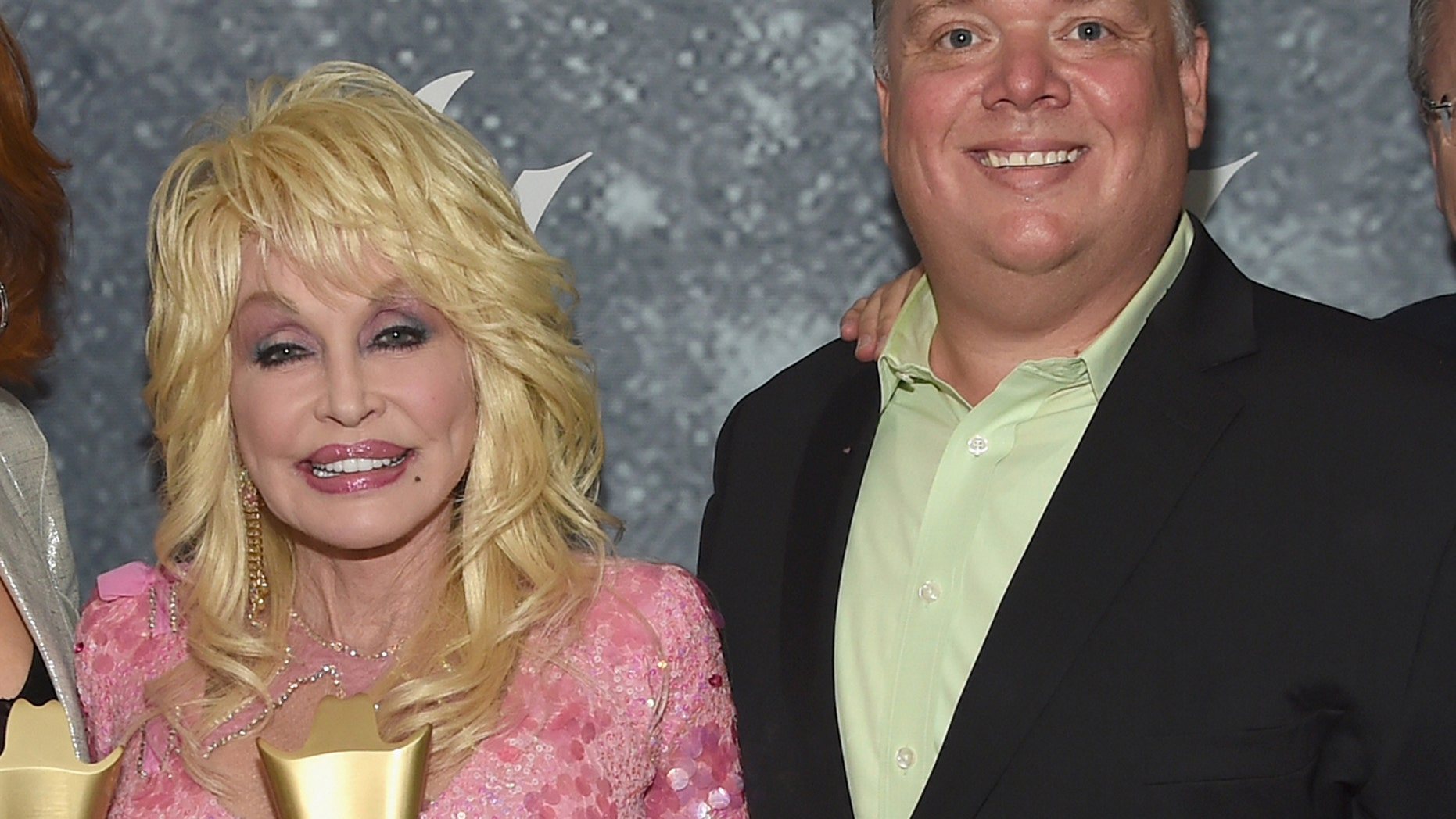 Dolly Parton (l) has parted ways with longtime publicist Kirt Webster (r) after the former PR powerhouse was accused of sexual assault and harassment by former clients and employees.