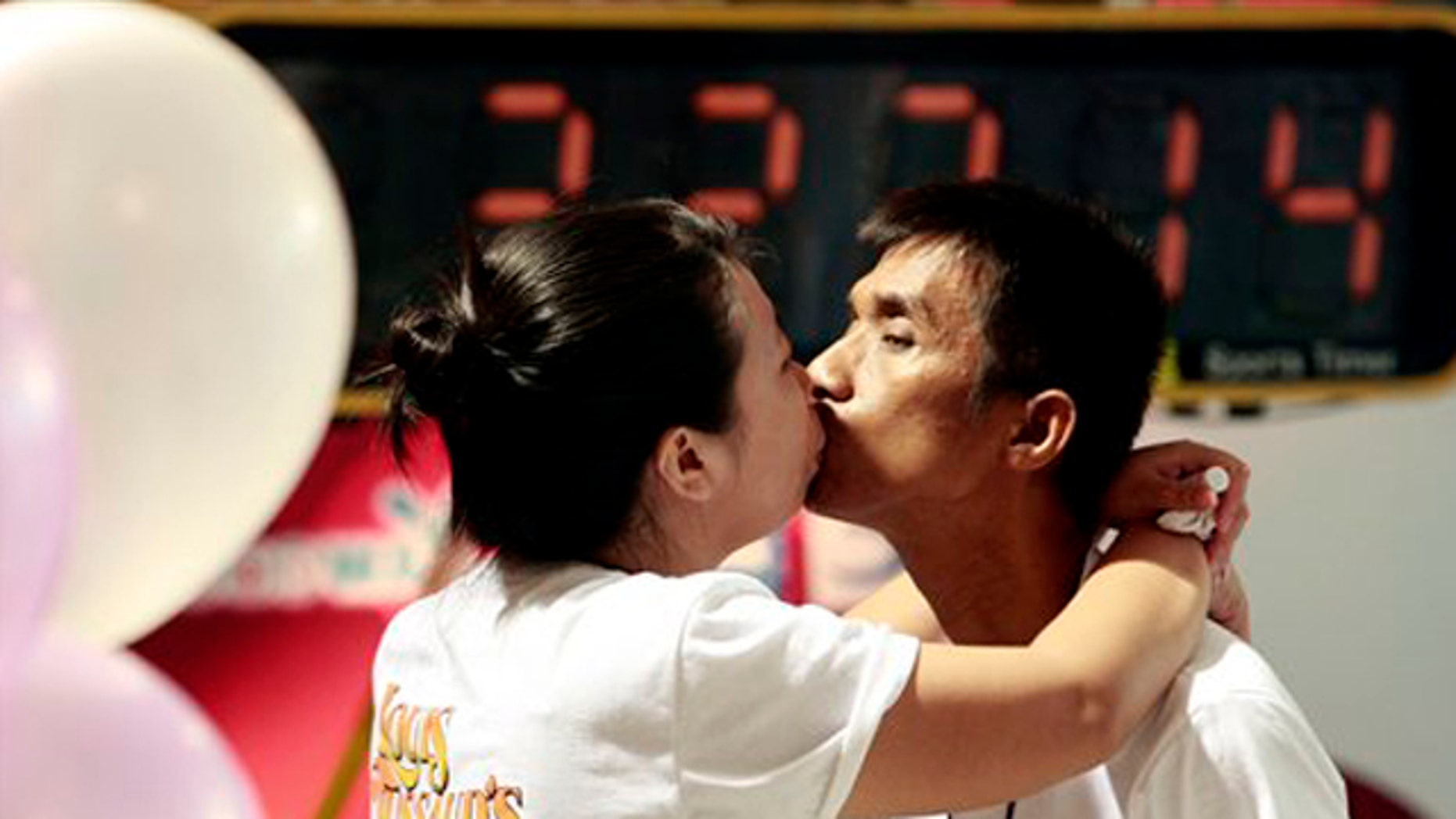 Feb. 13: Competitors, Laksana Tinarat, left, kisses her husband Ekachai during a World's Longest Continuous Kiss competition in Pattaya, southeastern Thailand. The event was held in an attempt to break the Guinness world record and to celebrate St. Valentine's Day. (AP)
