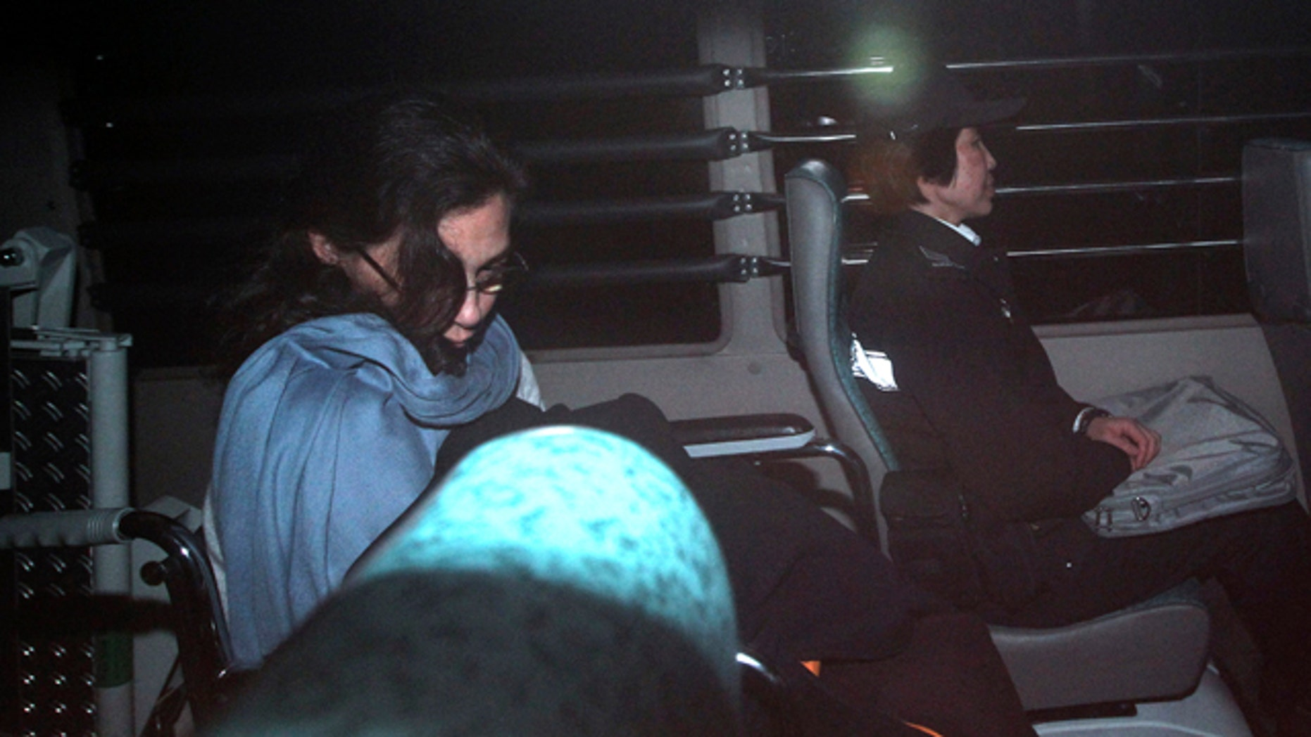 March 24: Nancy Kissel, left, an American woman accused of killing her husband, leaves the High Court by a prison van in Hong Kong. A Hong Kong jury is deliberating in the retrial of Kissel accused of murdering her wealthy husband after drugging his milkshake. (AP)