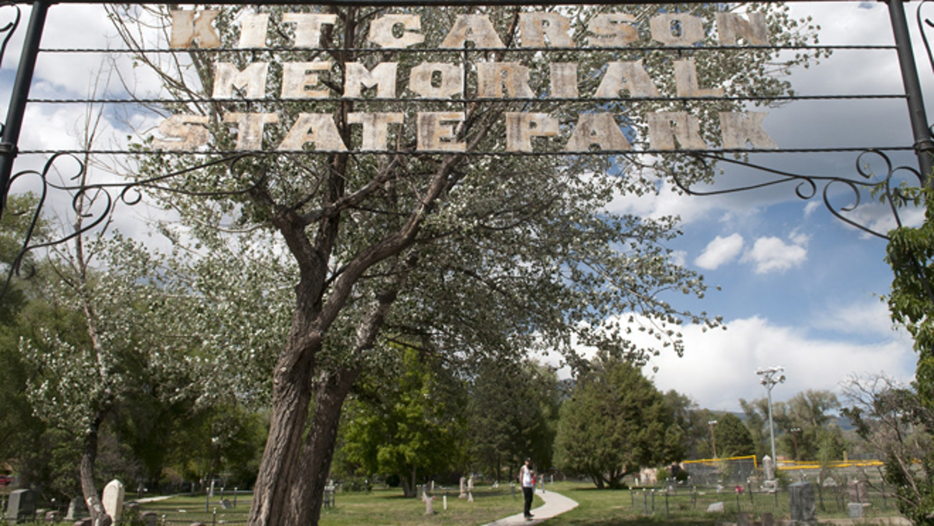 June 11, 2014: Devin Myers, from Taos, skateboards through Kit Carson Memorial Cemetery at Kit Carson Park in Taos, N.M.