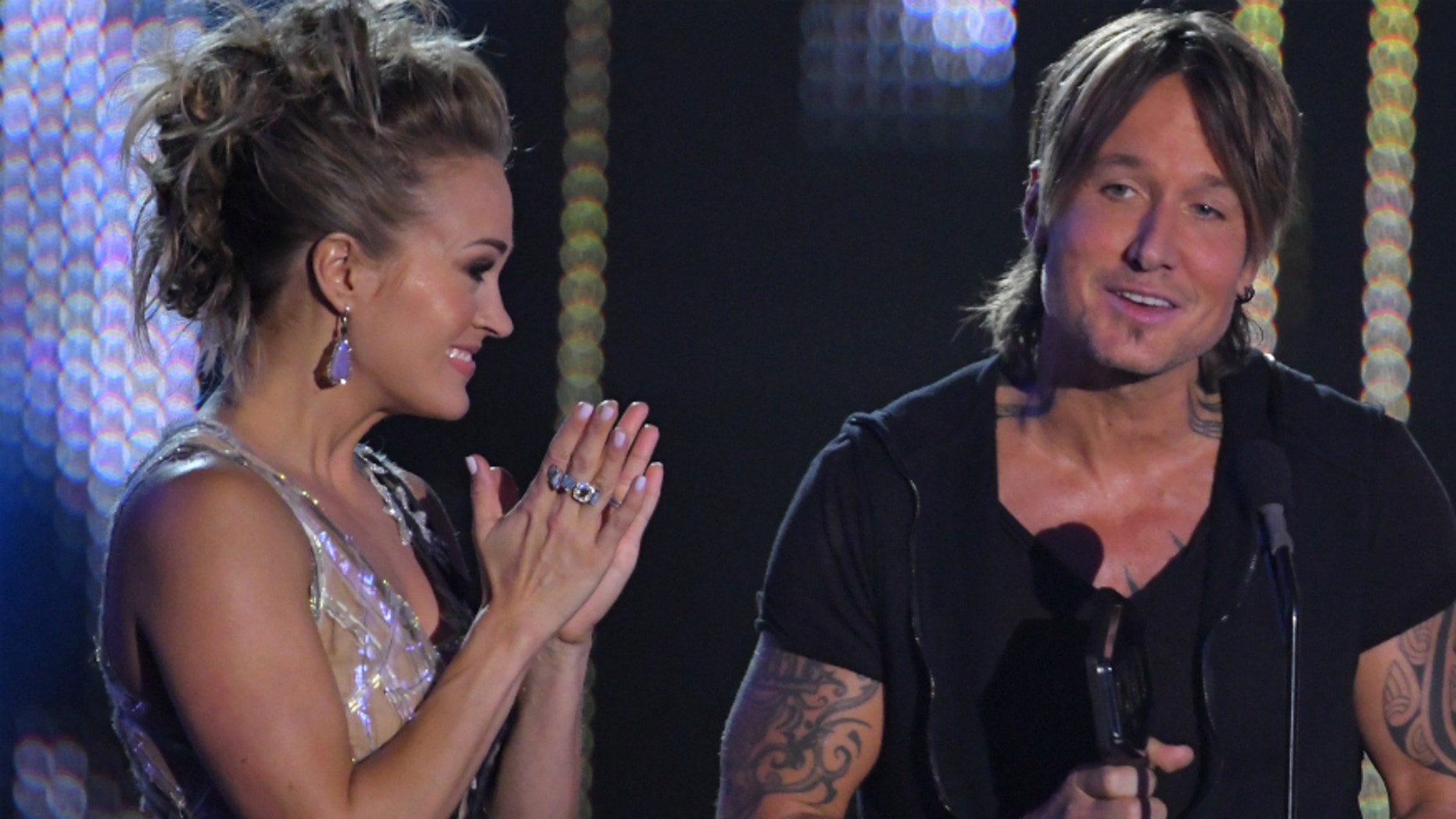 """Keith Urban and Carrie Underwood accept the Collaborative Video of the Year for """"The Fighter"""" at the CMT Awards on June 7, 2017."""