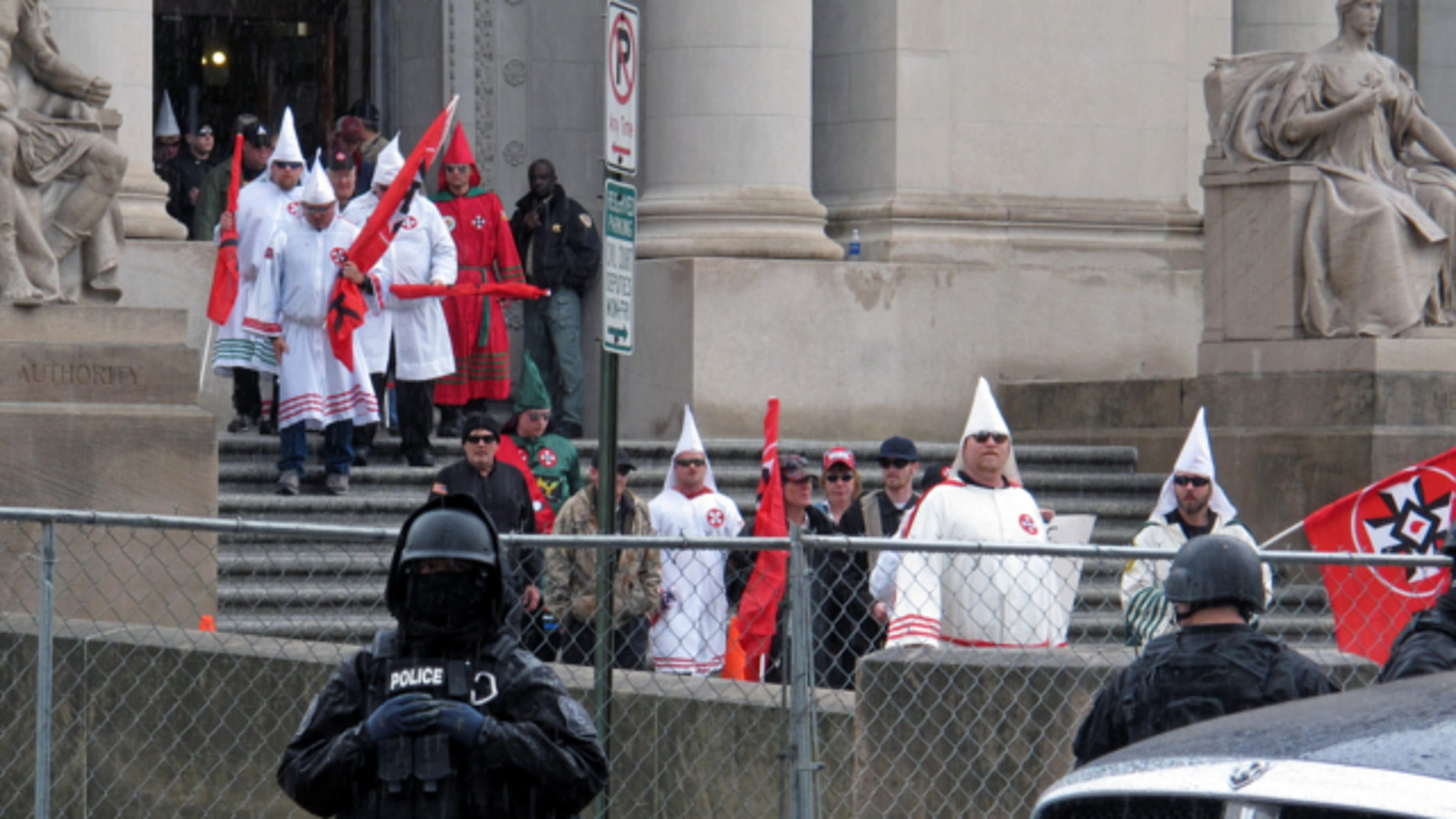 March 30, 2013: Ku Klux Klan members gather for a protest outside a courthouse in Memphis, Tenn.