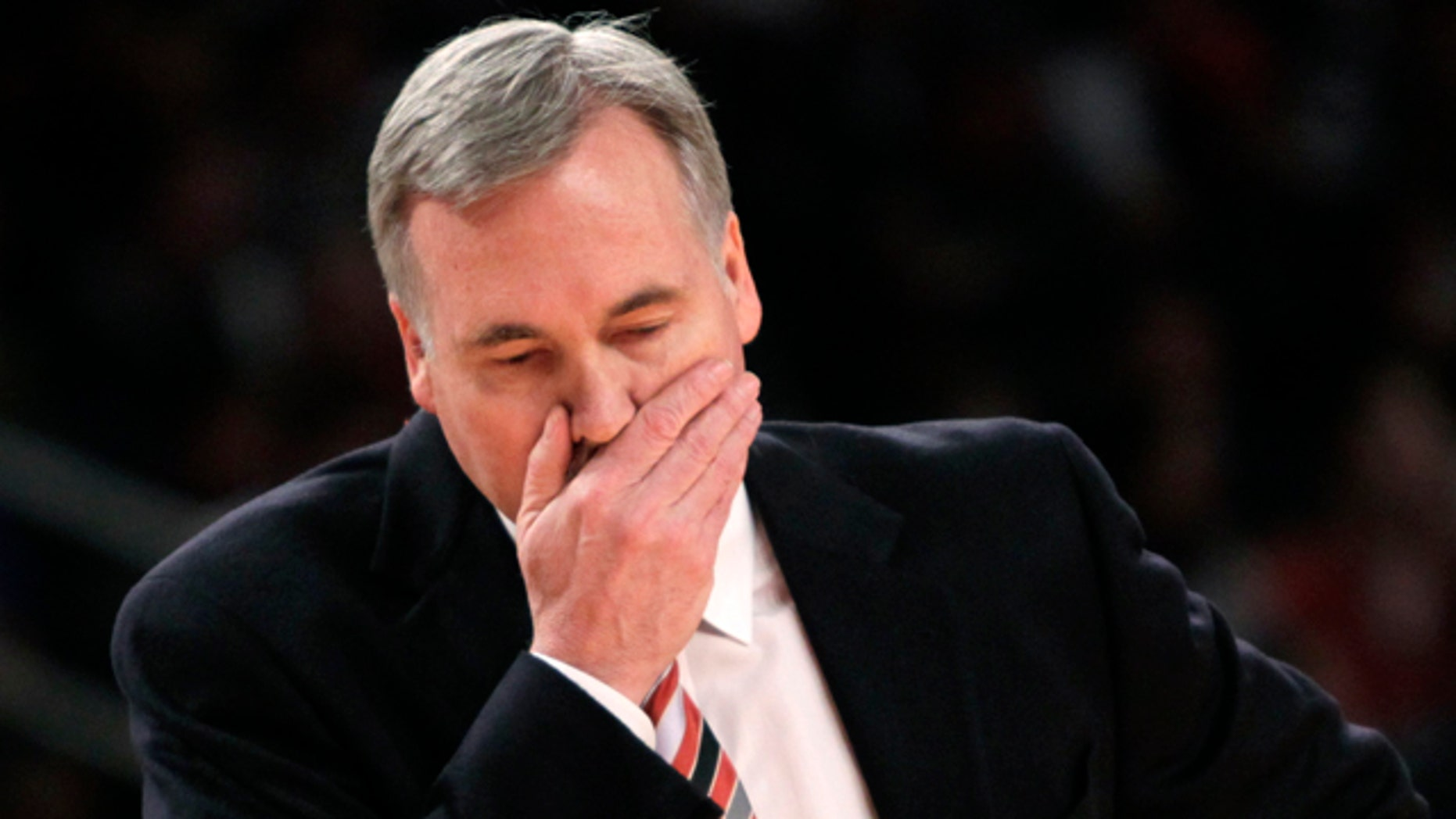 New York Knicks' head coach Mike D'Antoni walks onto the court during a time out during the first half of an NBA basketball game against the Philadelphia 76ers in New York, Sunday, March 11, 2012. The 76ers defeated the Knicks 106-94. (AP Photo/Seth Wenig)