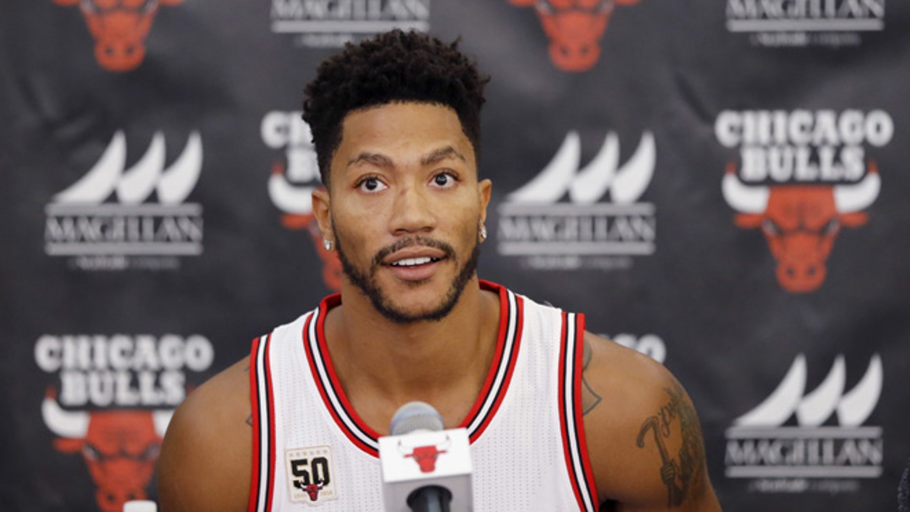 FILE - In this Sept. 28, 2015, file photo, Chicago Bulls' Derrick Rose sits down for an NBA basketball media day news conference in Chicago. (AP Photo/Charles Rex Arbogast, File)