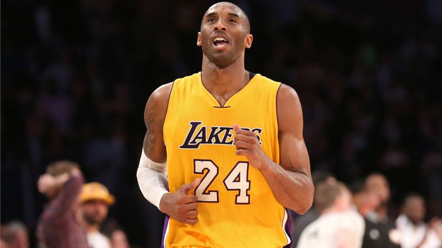 LOS ANGELES, CA - JANUARY 13: Kobe Bryant #24 of the Los Angeles Lakers reacts as he runs off the court after missing his three point attempt to tie the score as time ran out in the game against the Miami Heat at Staples Center on January 13, 2015 in Los Angeles, California. The Heat won 78-75. NOTE TO USER: User expressly acknowledges and agrees that, by downloading and or using this photograph, User is consenting to the terms and conditions of the Getty Images License Agreement. (Photo by Stephen Dunn/Getty Images)