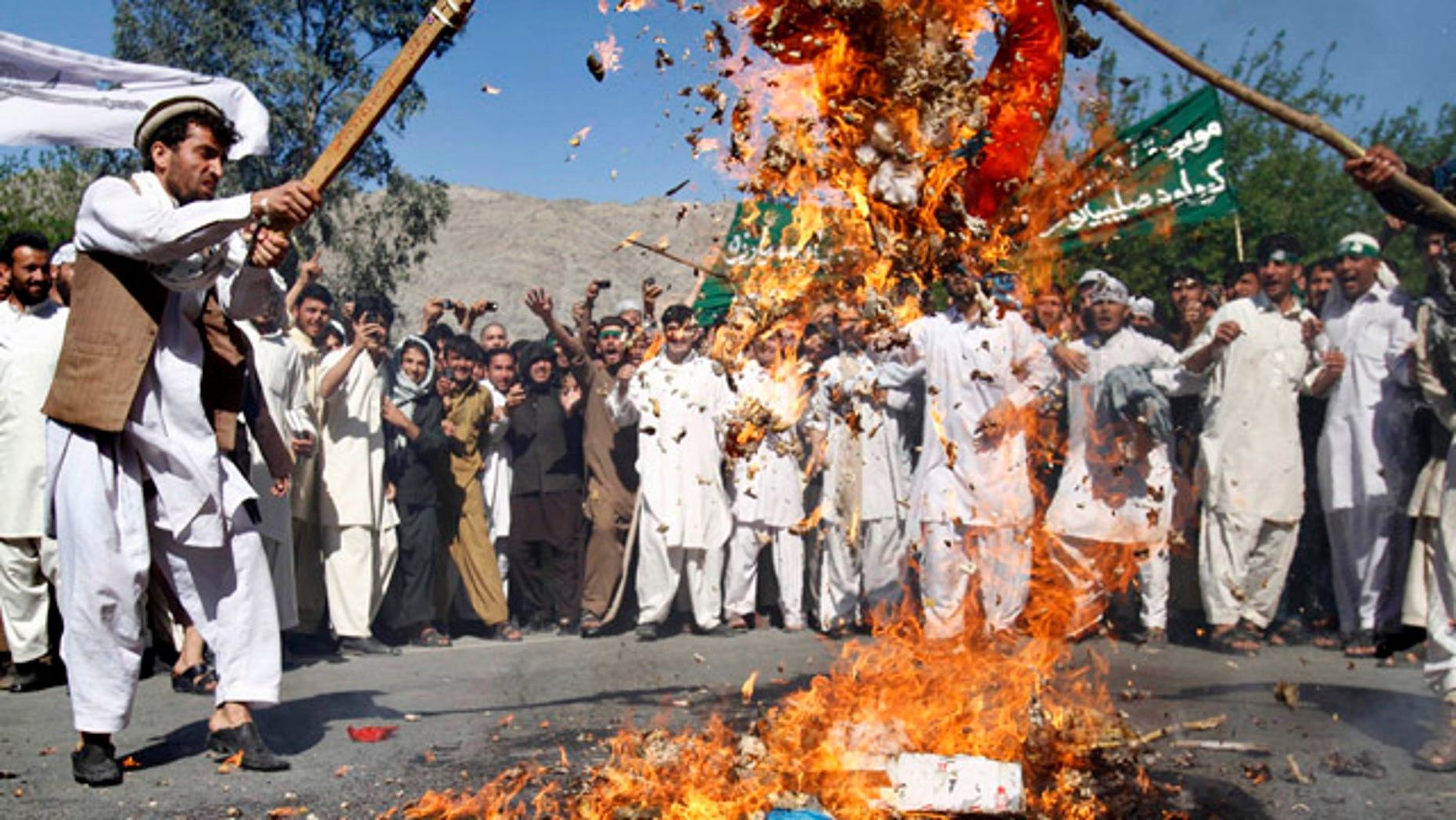 April 3, 2011: Afghan protestors burn an effigy of U.S. President Barack Obama during a demonstration in Jalalabad, Afghanistan. Afghan protests against the burning of a Koran in Florida entered a third day with a demonstration in the major eastern city Sunday, while the Taliban called on people to rise up, blaming government forces for any violence.
