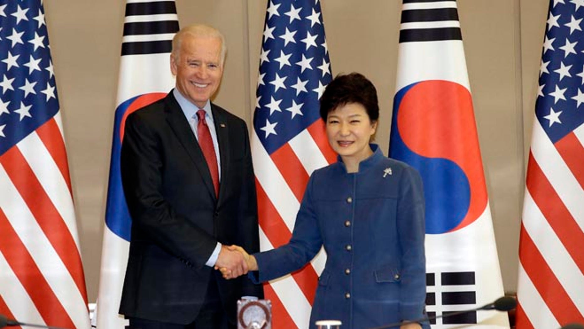 Dec. 6, 2013: South Korean President Park Geun-hye, right, shakes hands with U.S. Vice President Joe Biden before their meeting at the presidential Blue House in Seoul, South Korea.