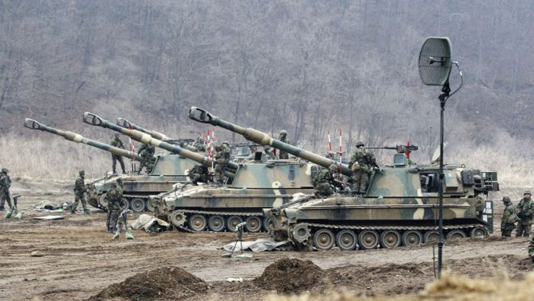FILE: March 7, 2013:  South Korean soldiers work on their K-9 self-propelled artillery vehicles during an exercise against possible attacks by North Korea near the border village of Panmunjom in Paju, South Korea.