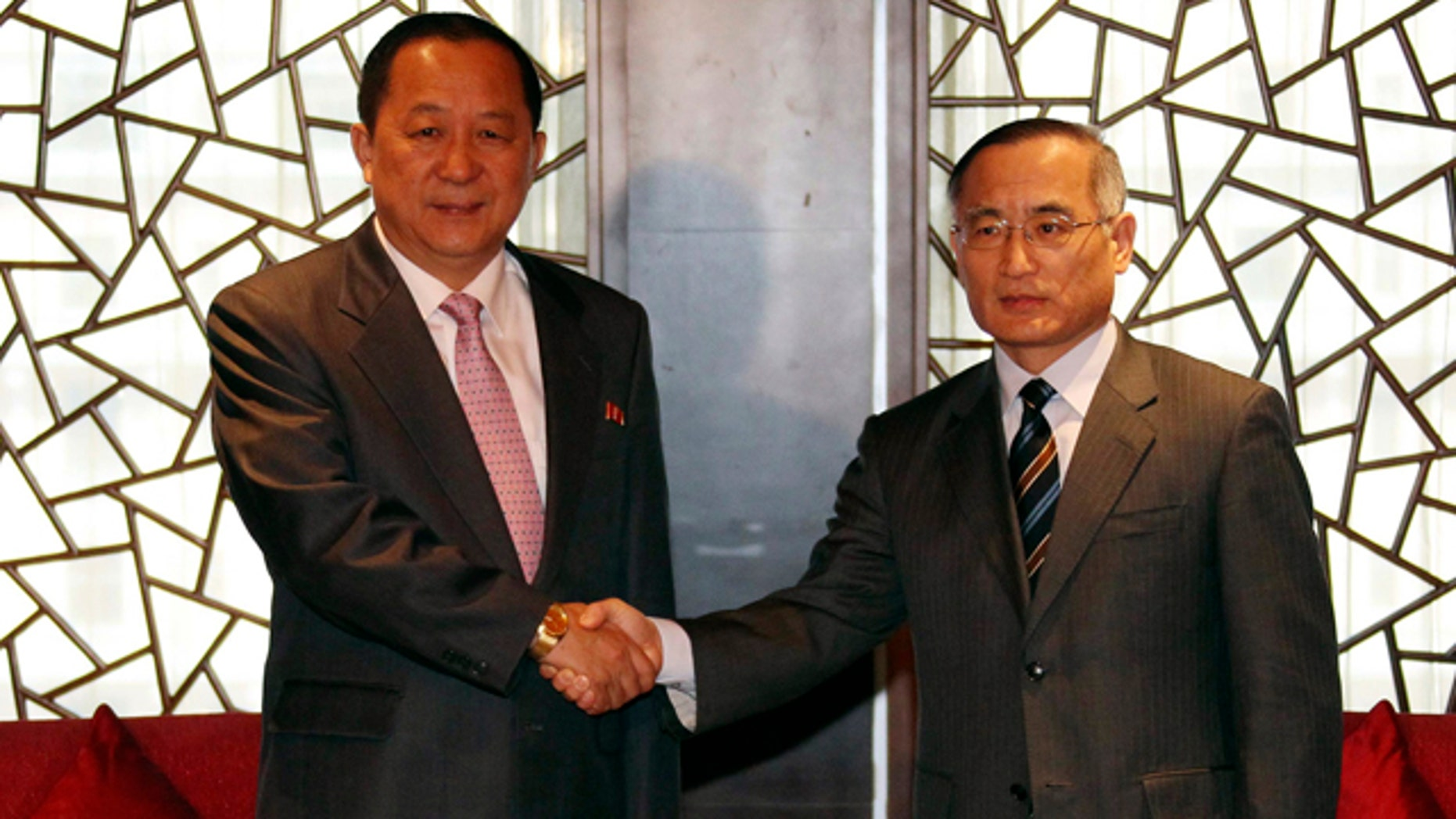Sept. 21: South Korean nuclear envoy Wi Sung-lac, right, shakes hands with his North Korea's counterpart Ri Yong Ho at the private Chang An Club in Beijing, China.