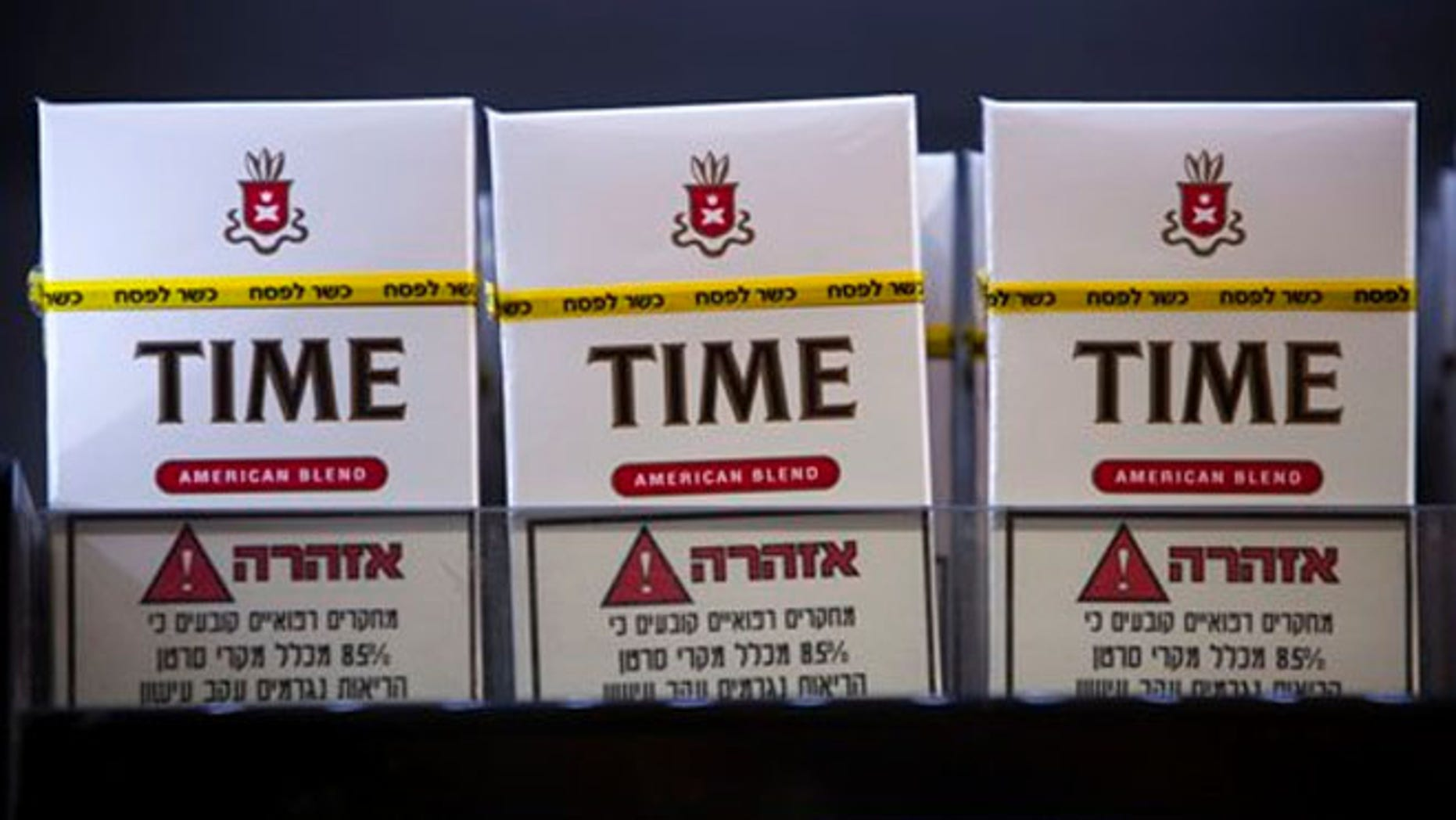"""March. 25, 2013: Cigarettes are for sale with a stamp of approval reading in Hebrew, """"kosher for Passover"""" at a kiosk in the Jewish ultra-Orthodox town of Bnei Brak, near Tel Aviv."""